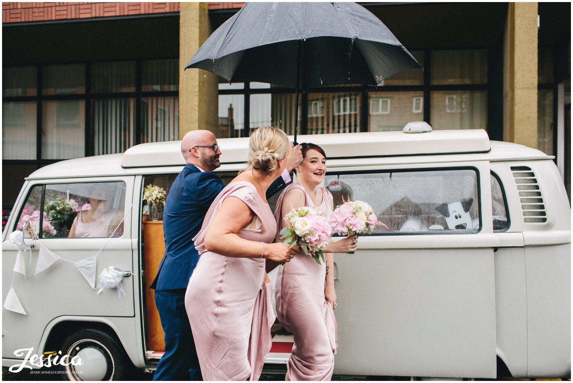 bridesmaids getting out of VW camper at Chester Registry Office