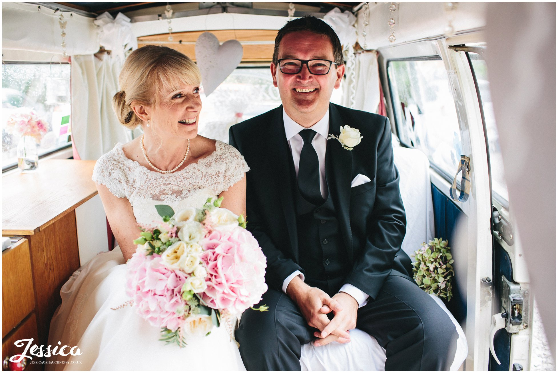 newly wed's sat in vintage vw campervan after their wedding in chester