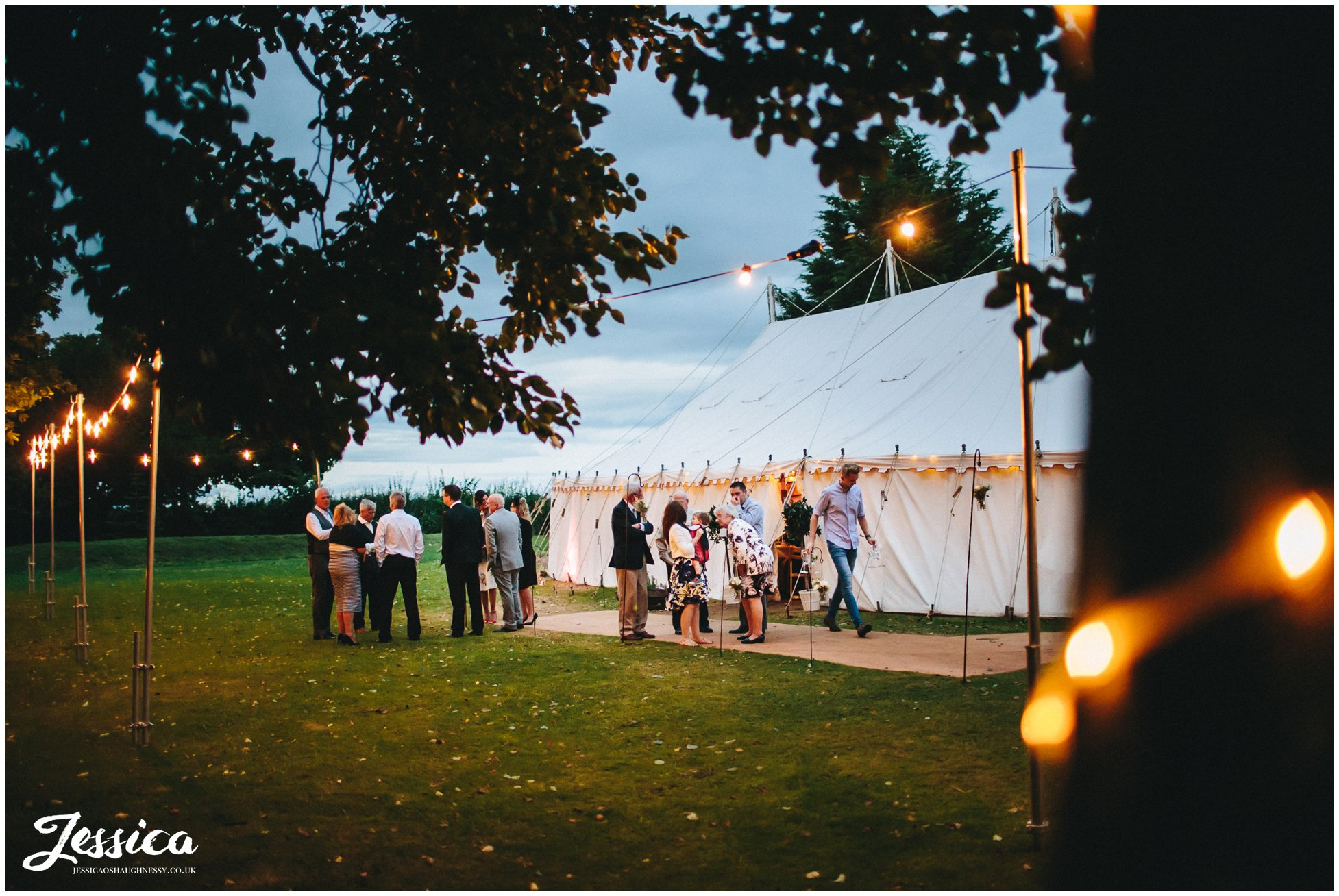 cholmondeley arms wedding marquee lit by fairy lights at night