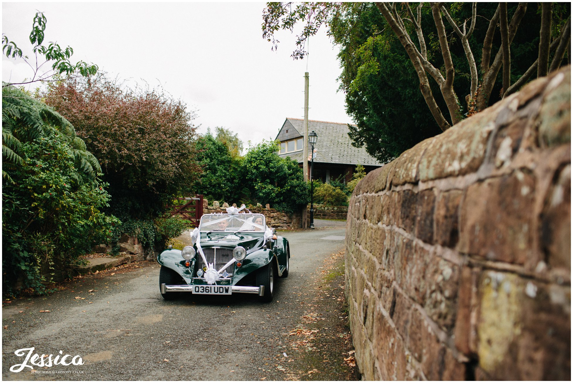 bride arrives at farndon church in a green kit car