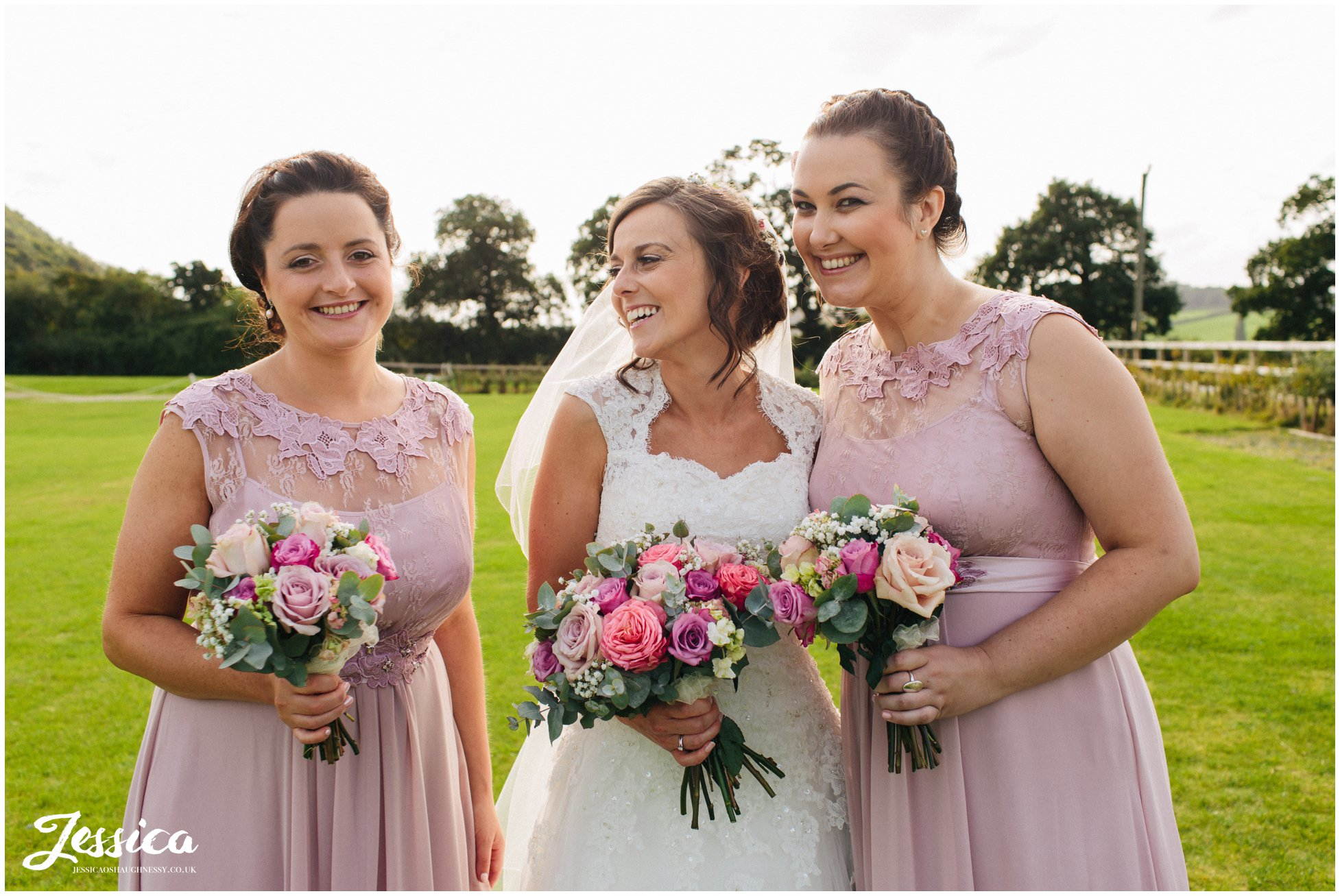 bride & her bridesmaids pose for a photograph at harthill weddings