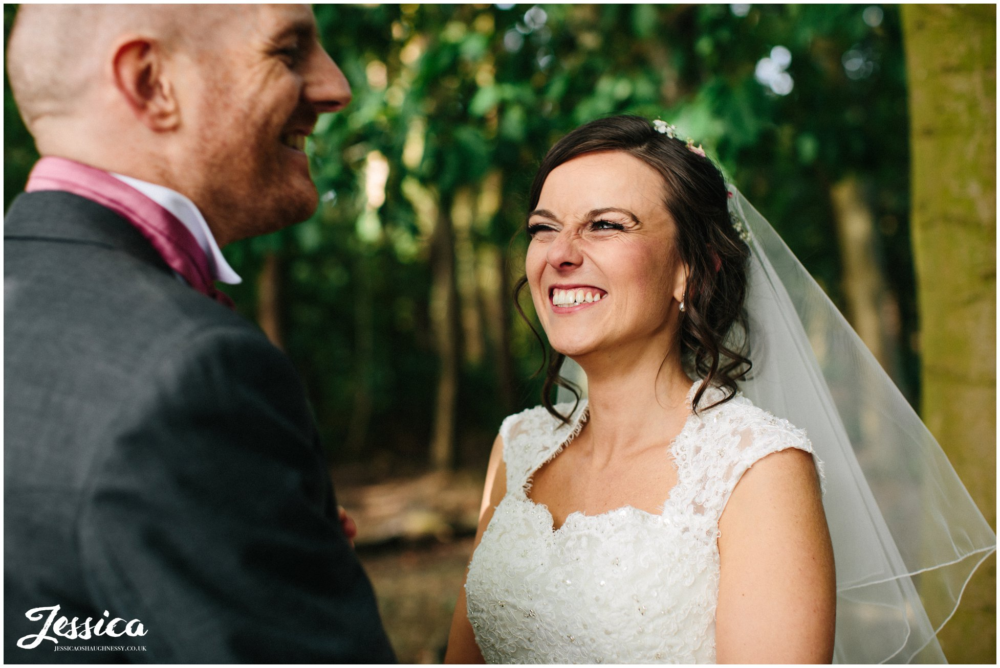 bride laughing at her groom on their wedding day - cheshire wedding photography
