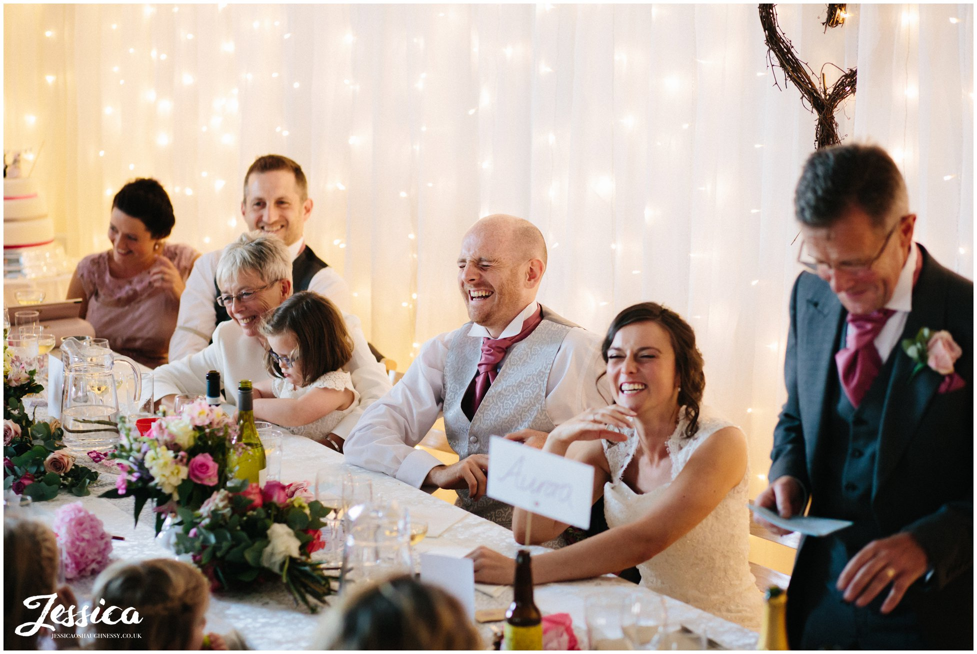 top table laugh during father of the bride speech, cheshire