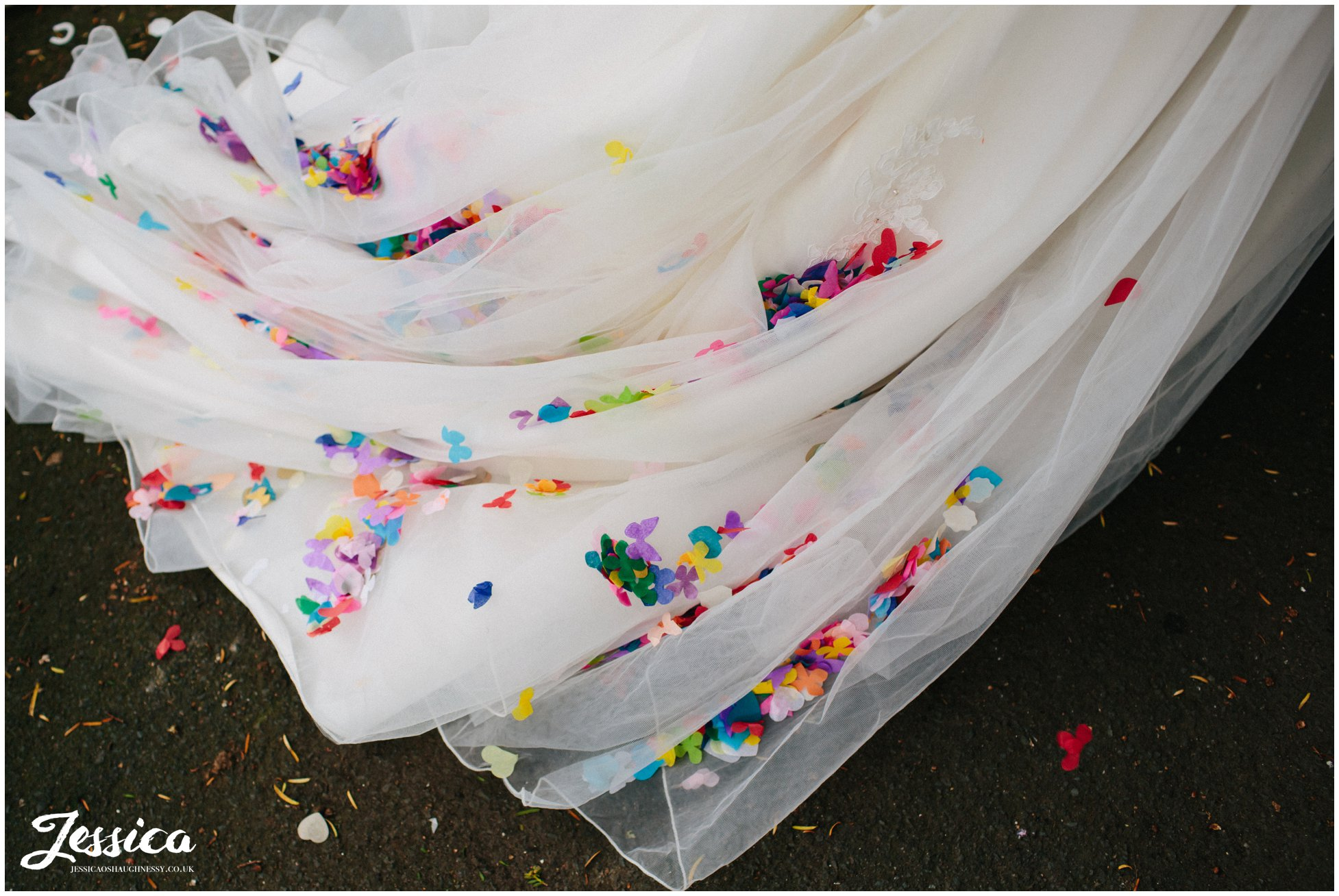colourful confetti on the brides dress at her wedding in cheshire