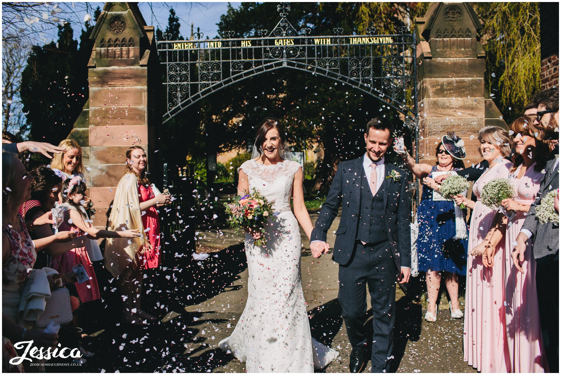 guests throw confetti and the bride and groom leave for their reception