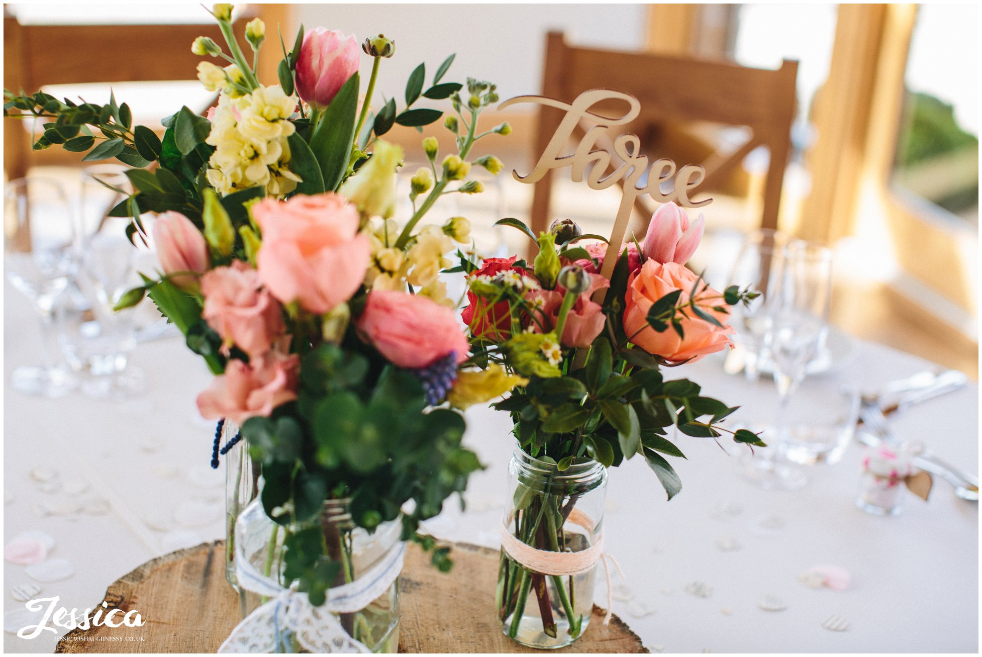 rustic flowers decorate each table at tower hill barns - north wales