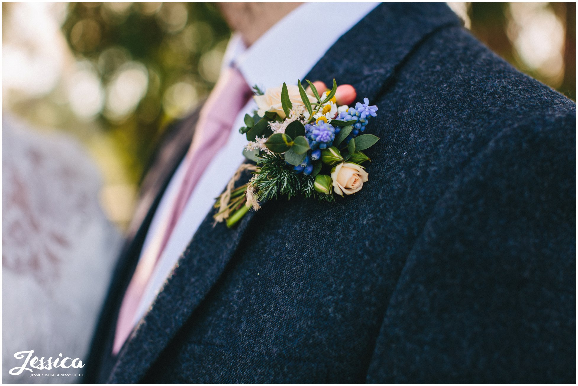 close up of the grooms rustic button hole