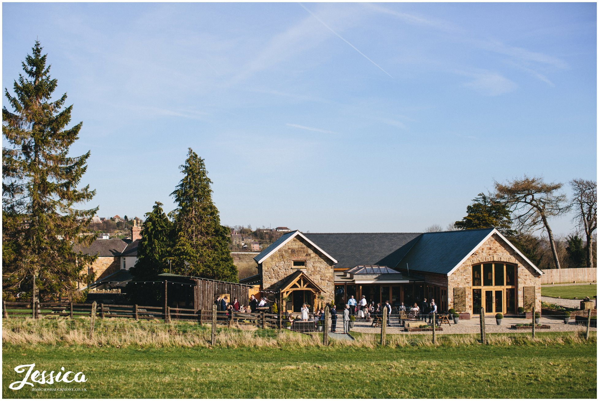 a view of tower hill barns at a sunny north wales wedding