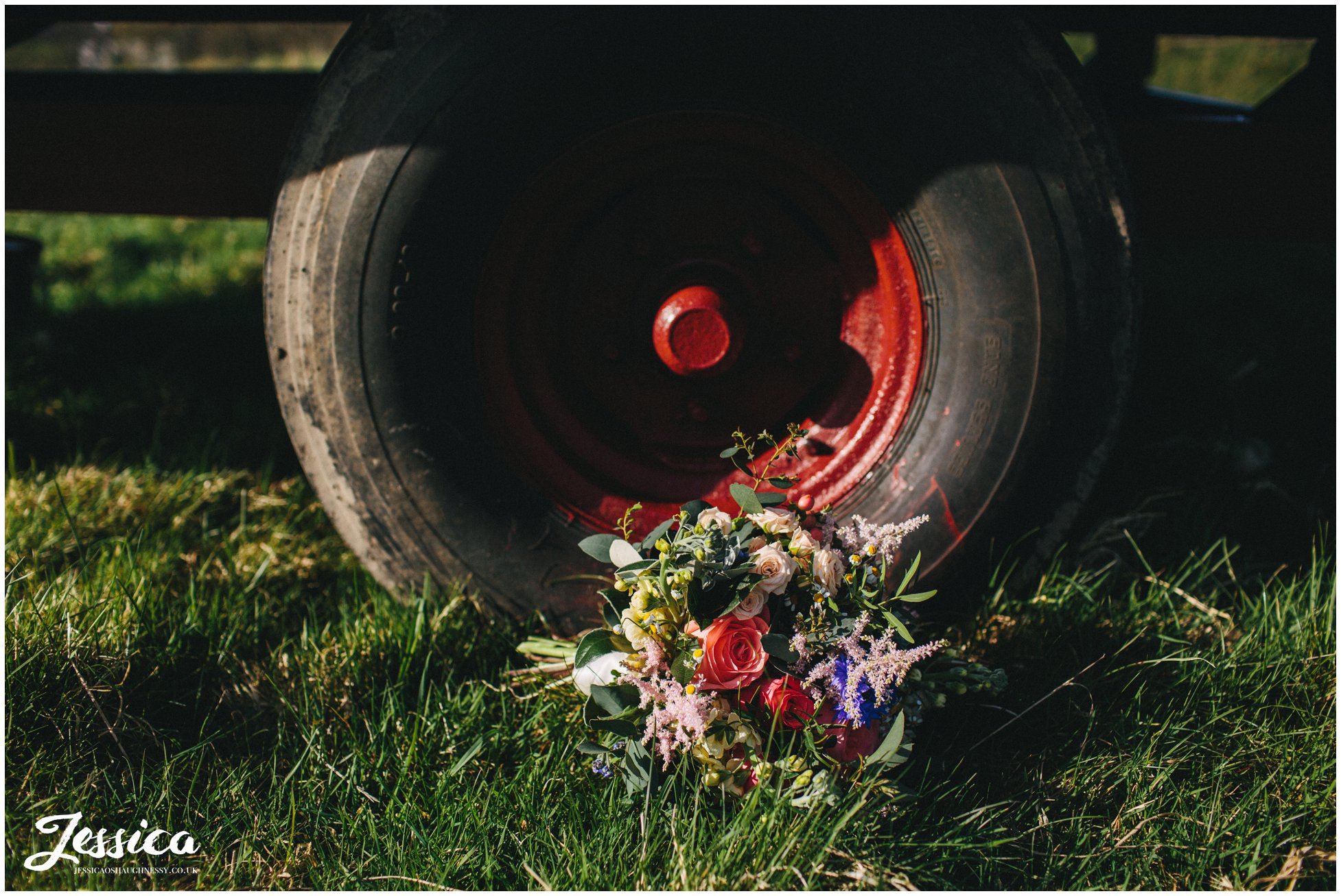 bouquet laid in front of farm wheel in north wales