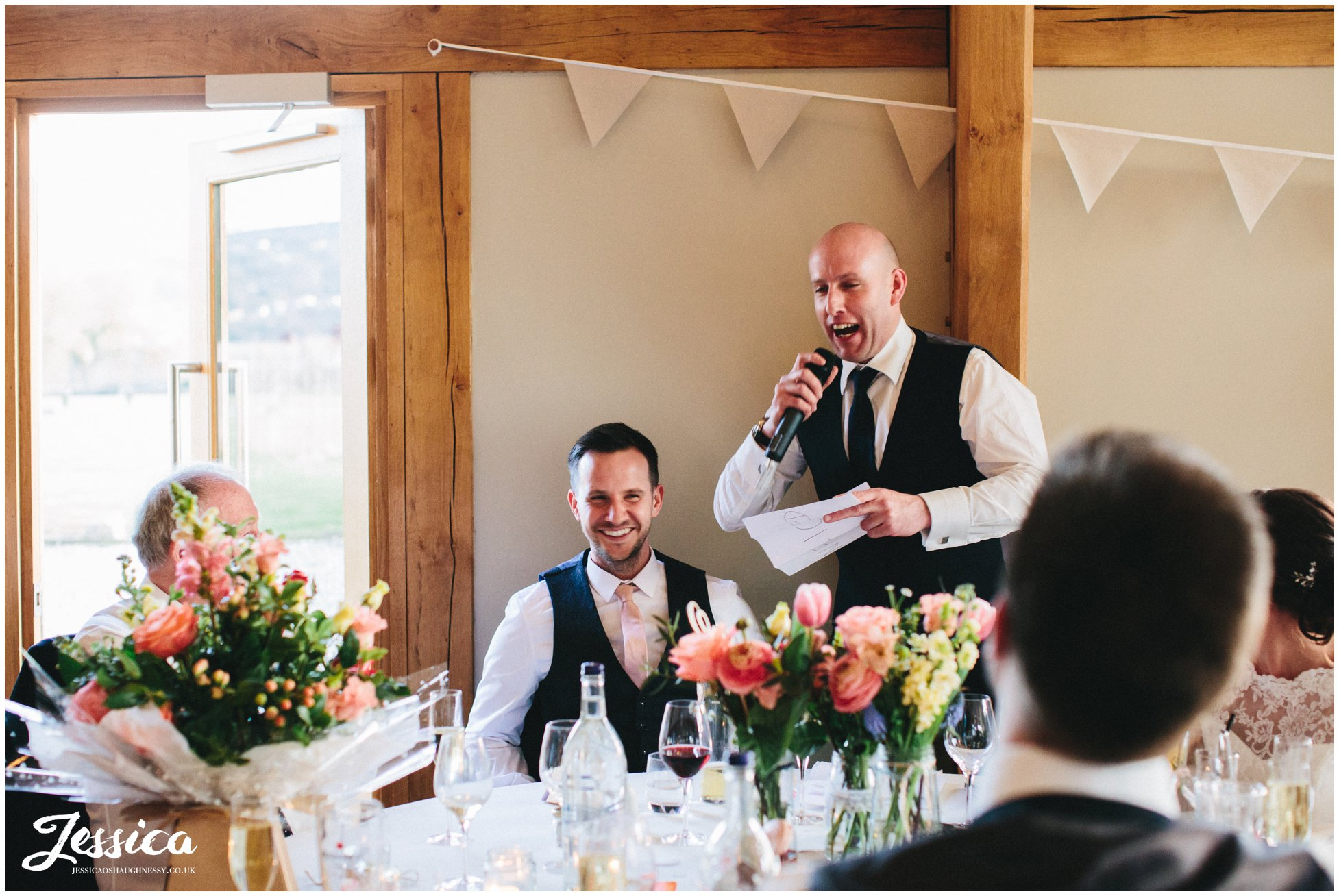 groom laughs during his best mans speech at tower hill barns wedding