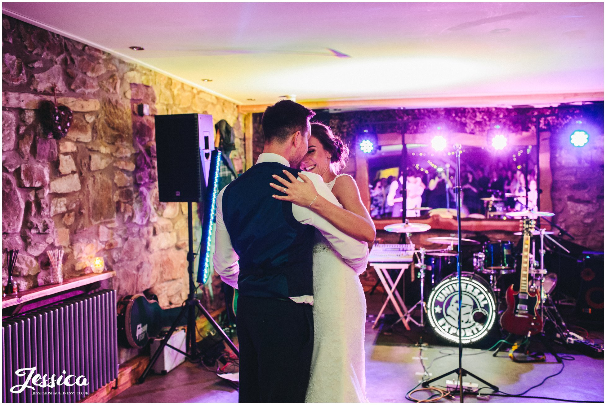 bride & groom share first dance in the barn - north wales wedding photographer