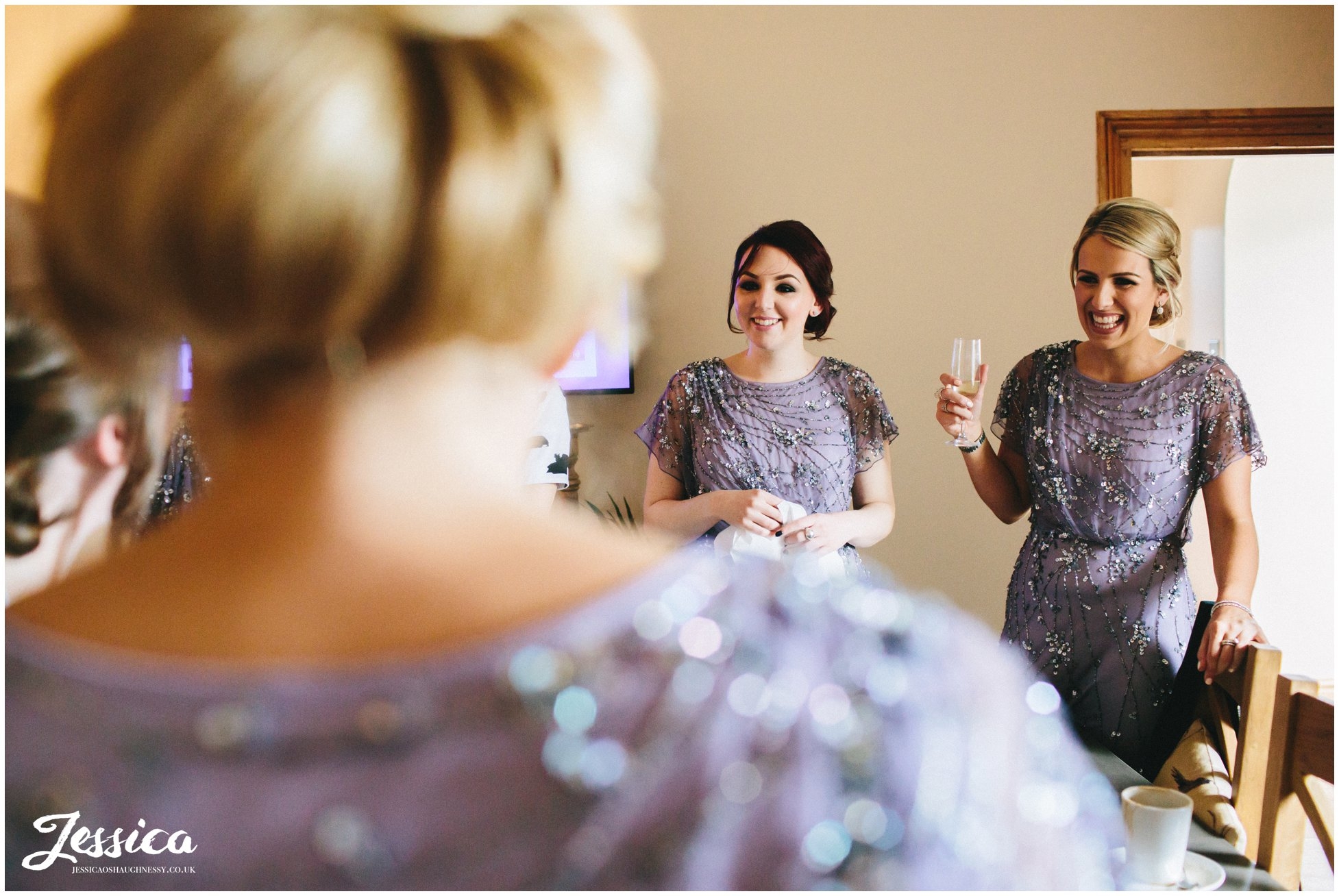 bridesmaids smiling in the cottages at tower hill barns