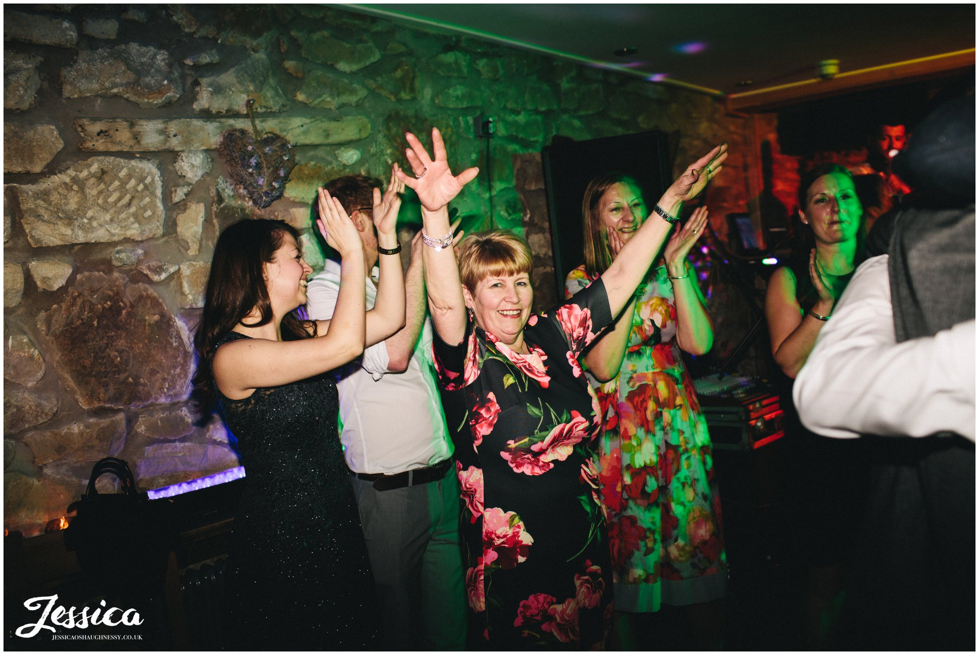 guests dance with their hands in the air