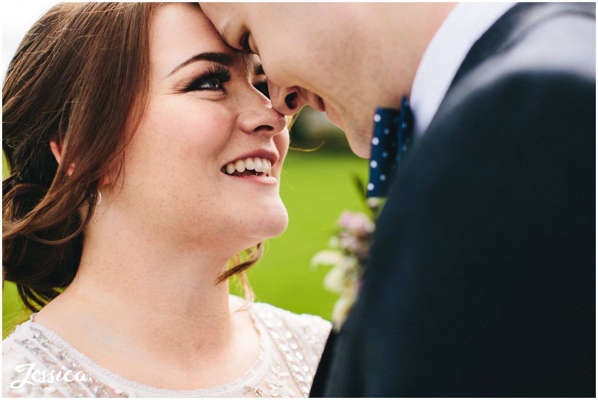close up on bride smiling at her groom at tower hill barns