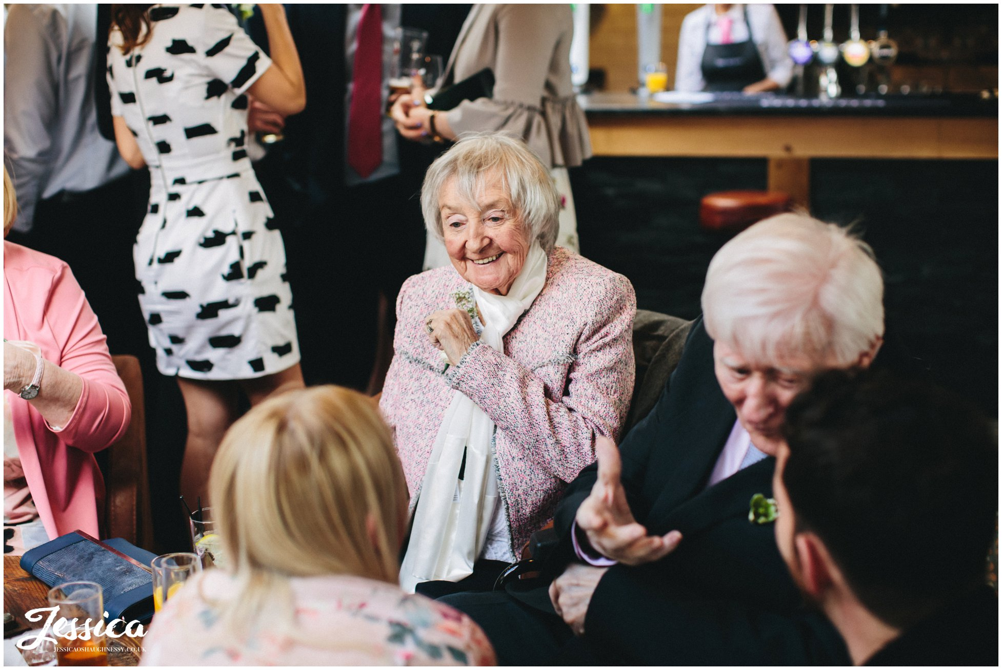 grandmother laughing at her granddaughters wedding