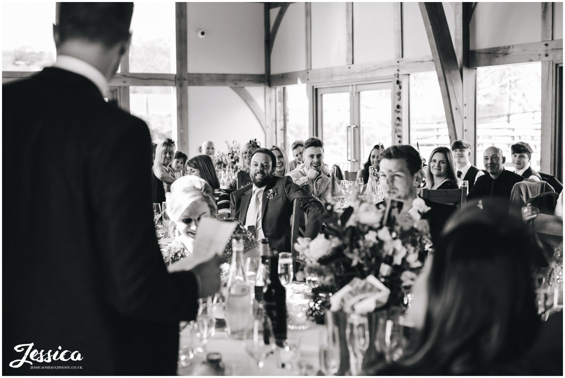 guests reactions to the speeches at a north wales wedding in wrexham