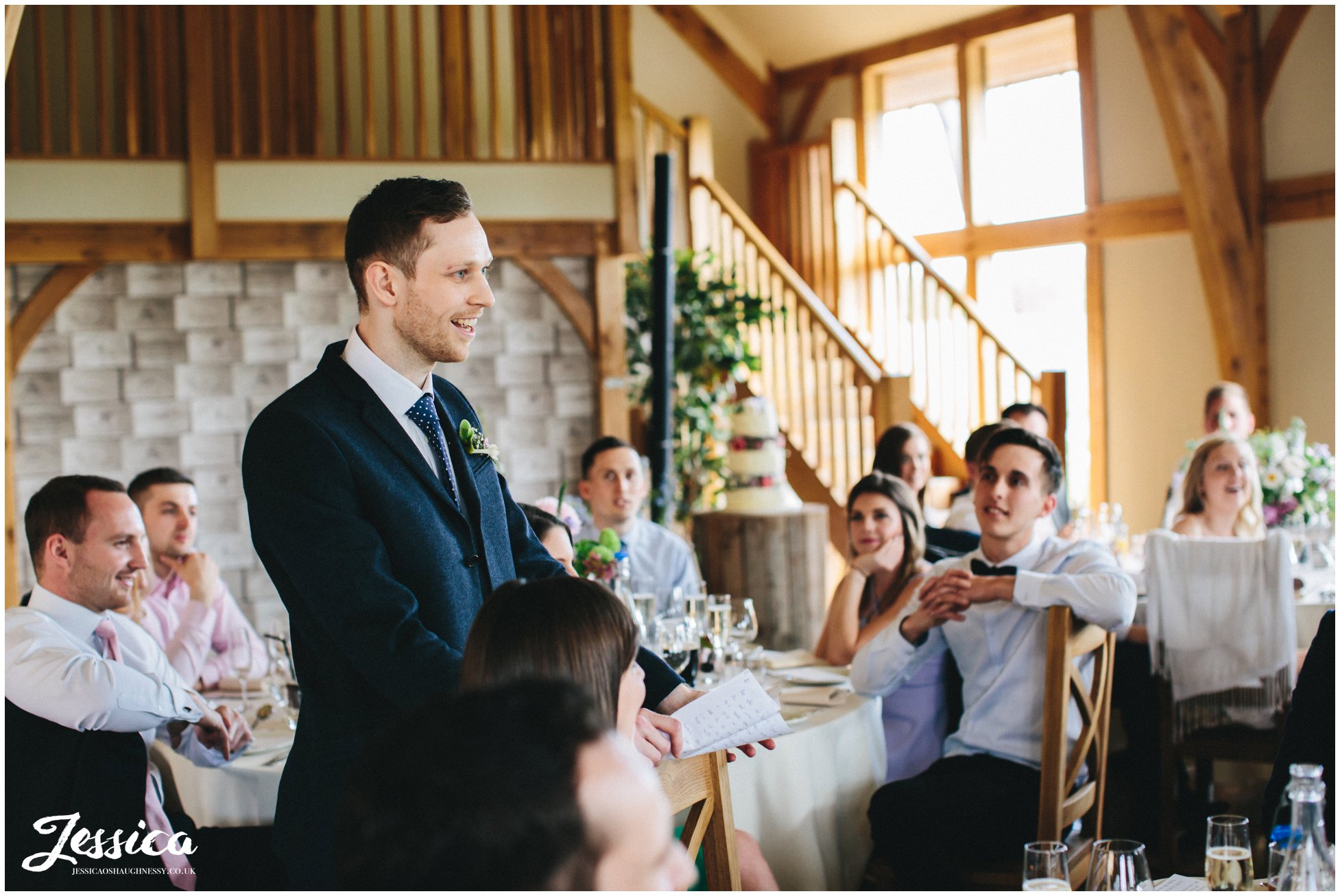 best man smiling whilst delivering his speech at tower hill barns