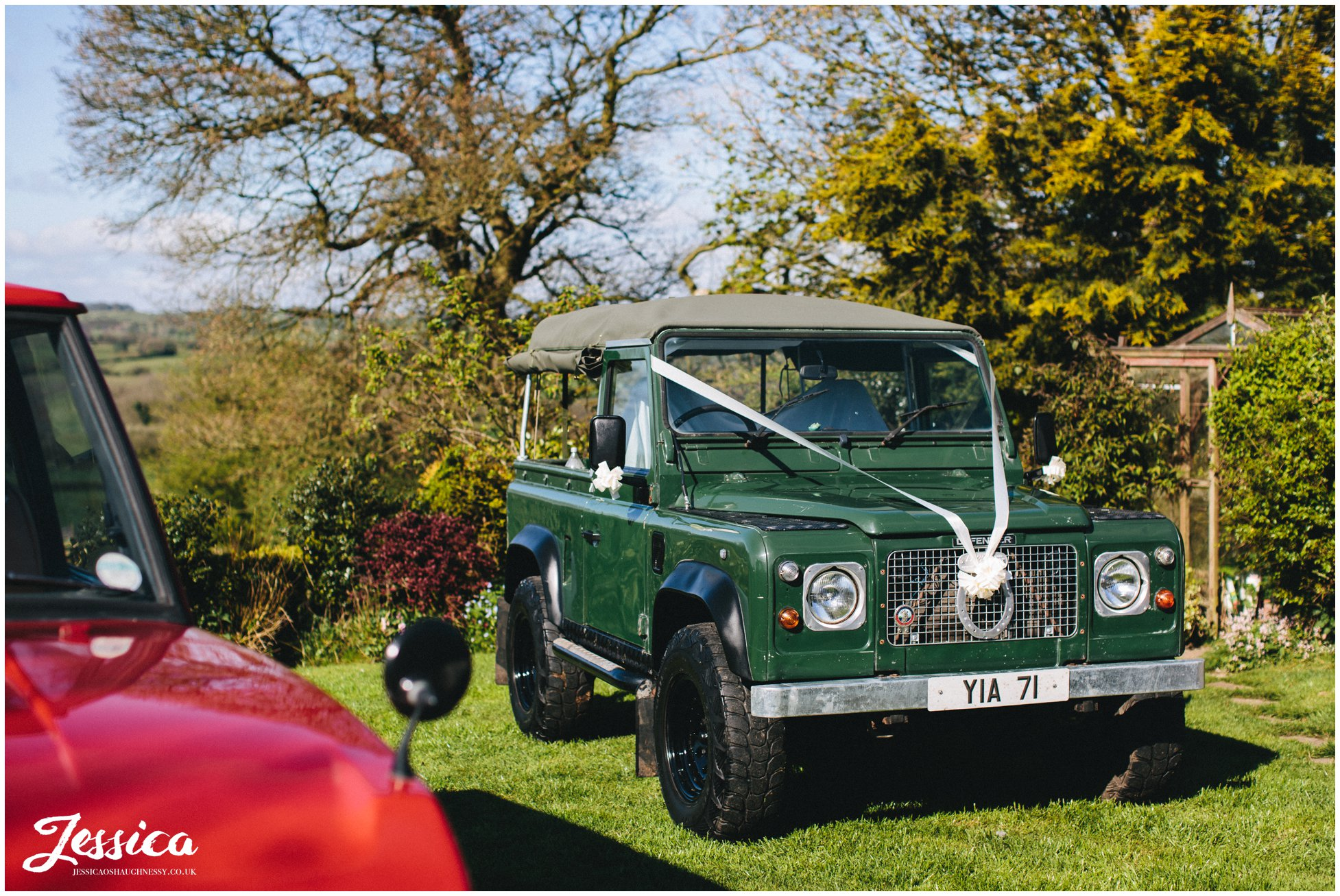 a green land rover to take the bride to the church