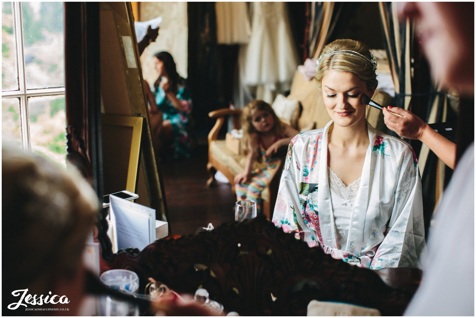 bride gets make up done on the morning of her wedding at trevor hall in wrexham