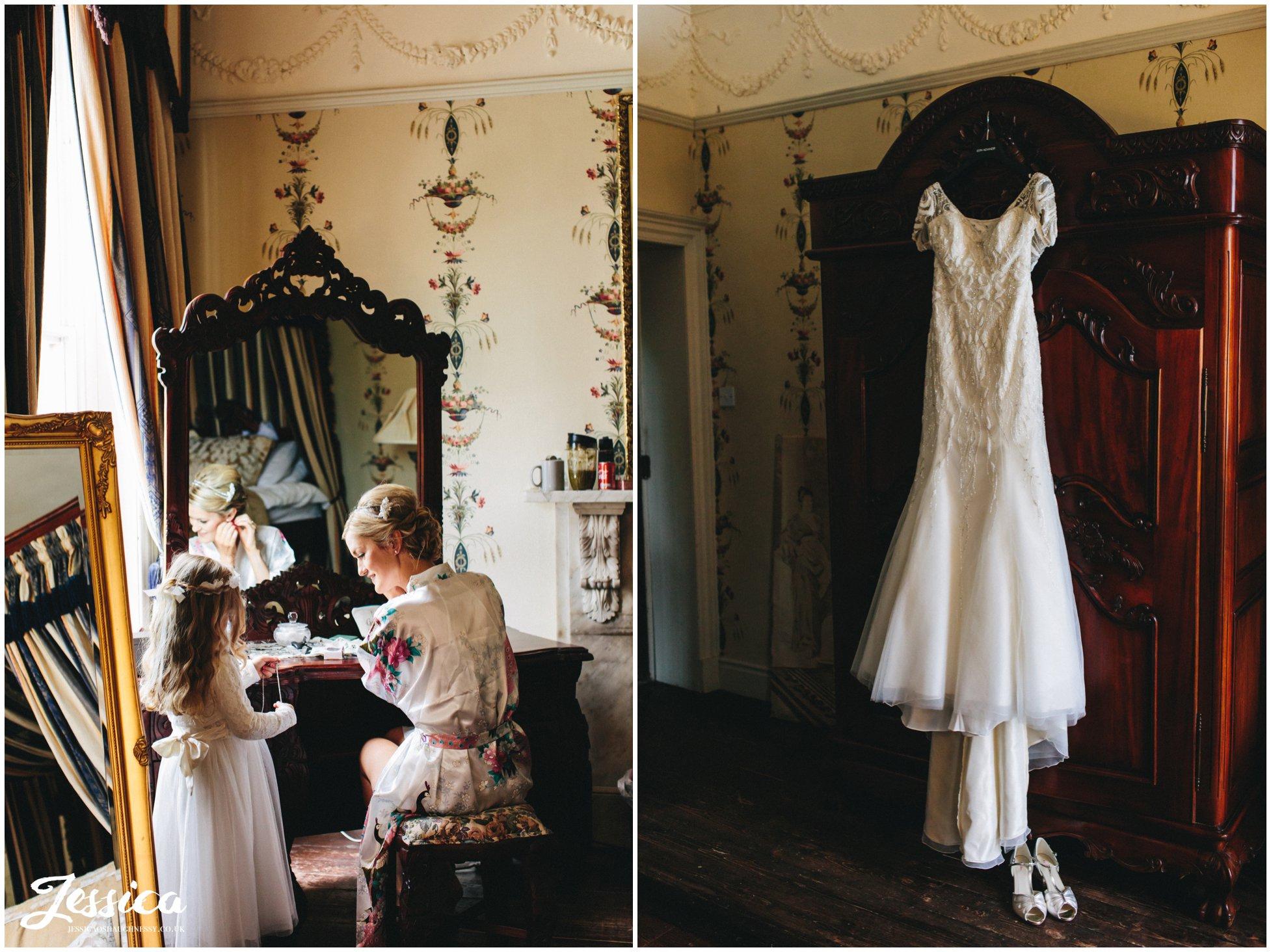 trevor hall wedding photography - wedding dress hanging from wardrobe