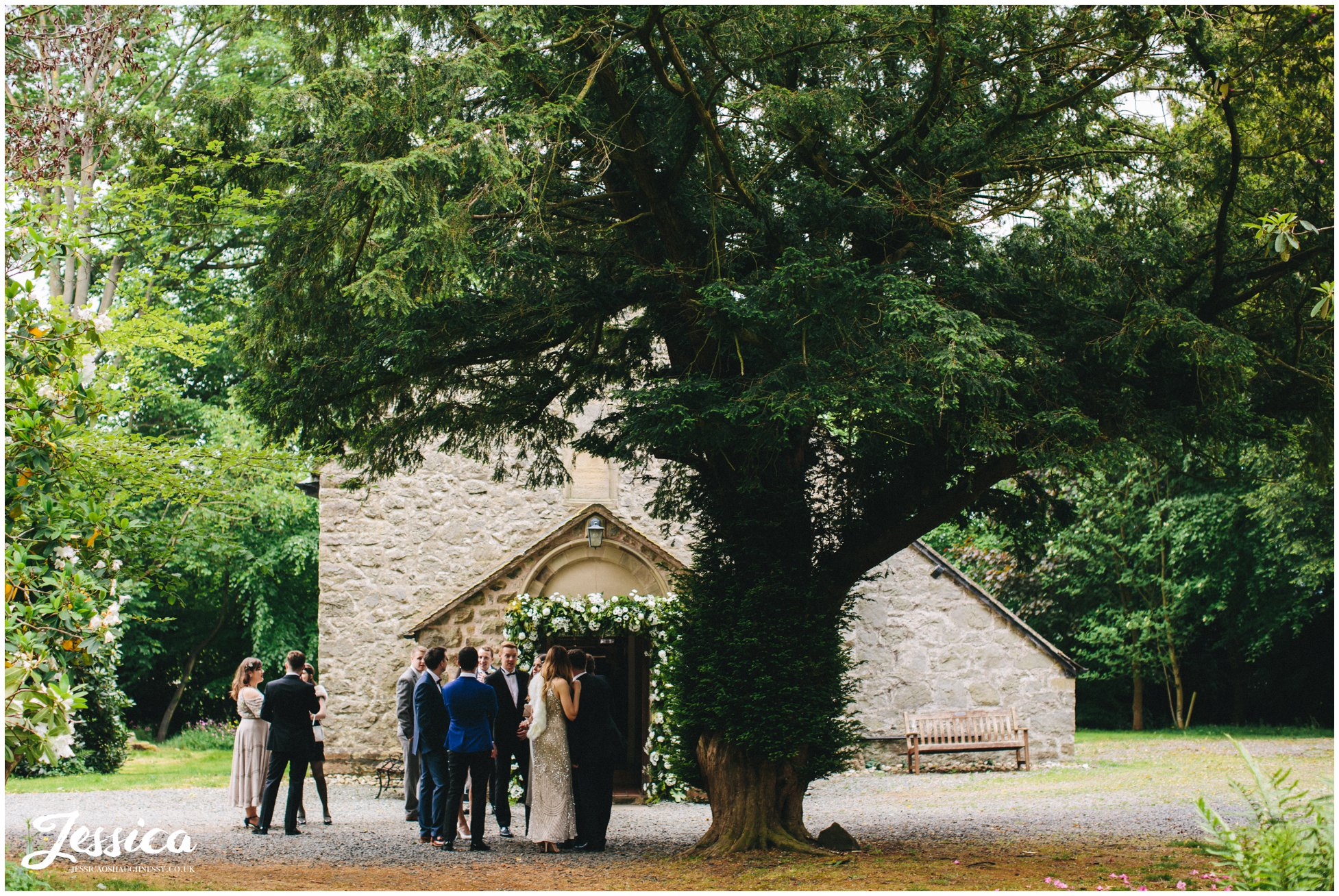 guests gather outside trevor hall's church