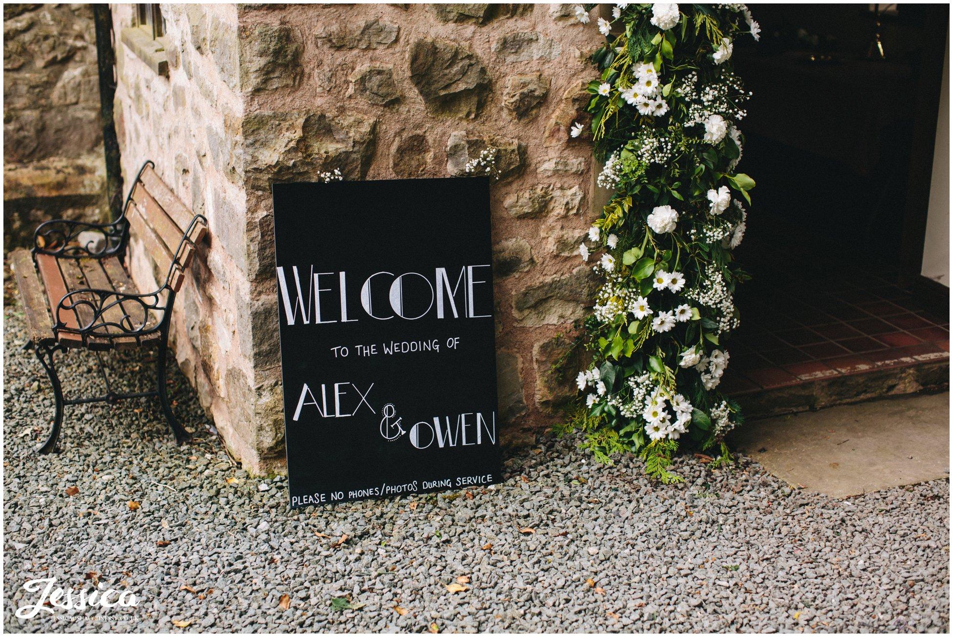 Alex & owen's wedding sign outside Trevor Church in North wales