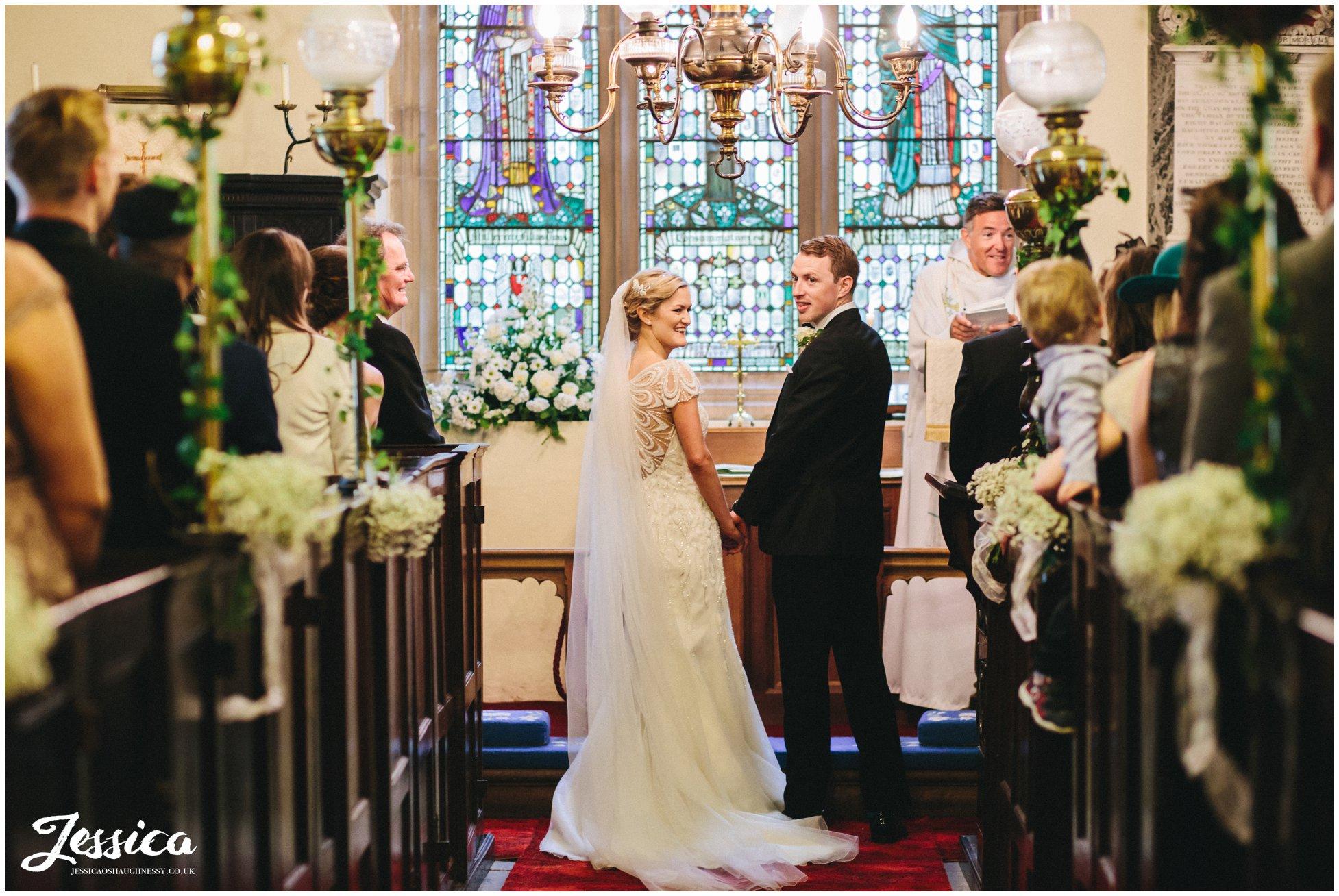 Bride & Groom during their wedding ceremony at Trevor Church