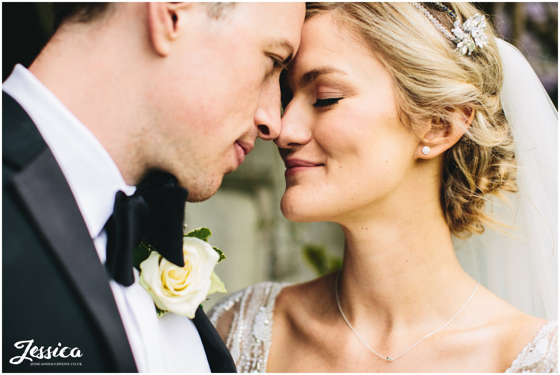 close up of bride & groom on their trevor hall wedding day