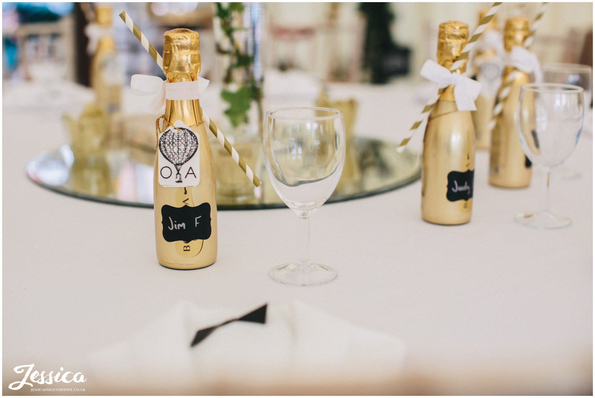 champagne favours decorate the tables at a wedding at trevor hall in north wales