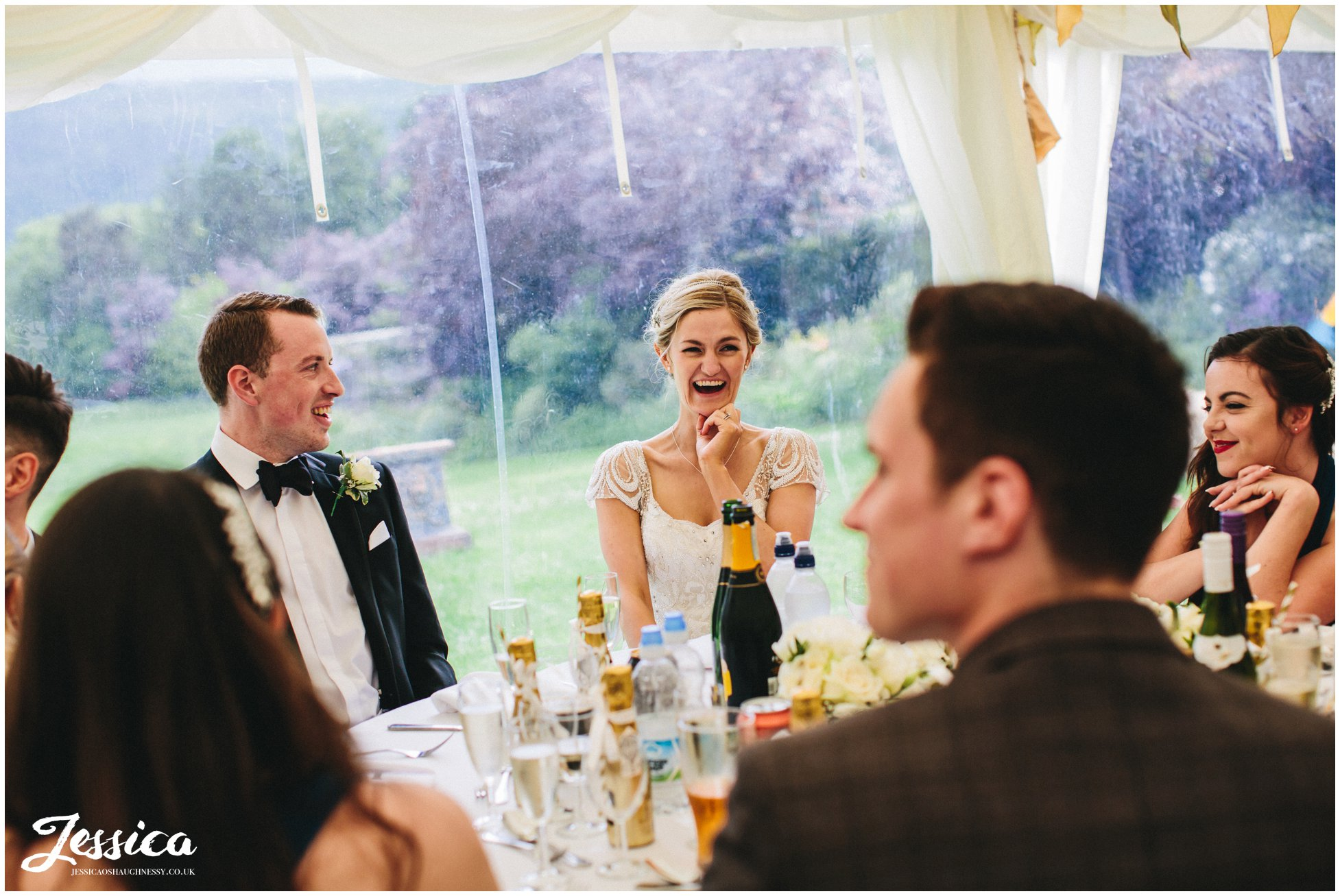 north wales wedding photographer - bride laughing during the speeches