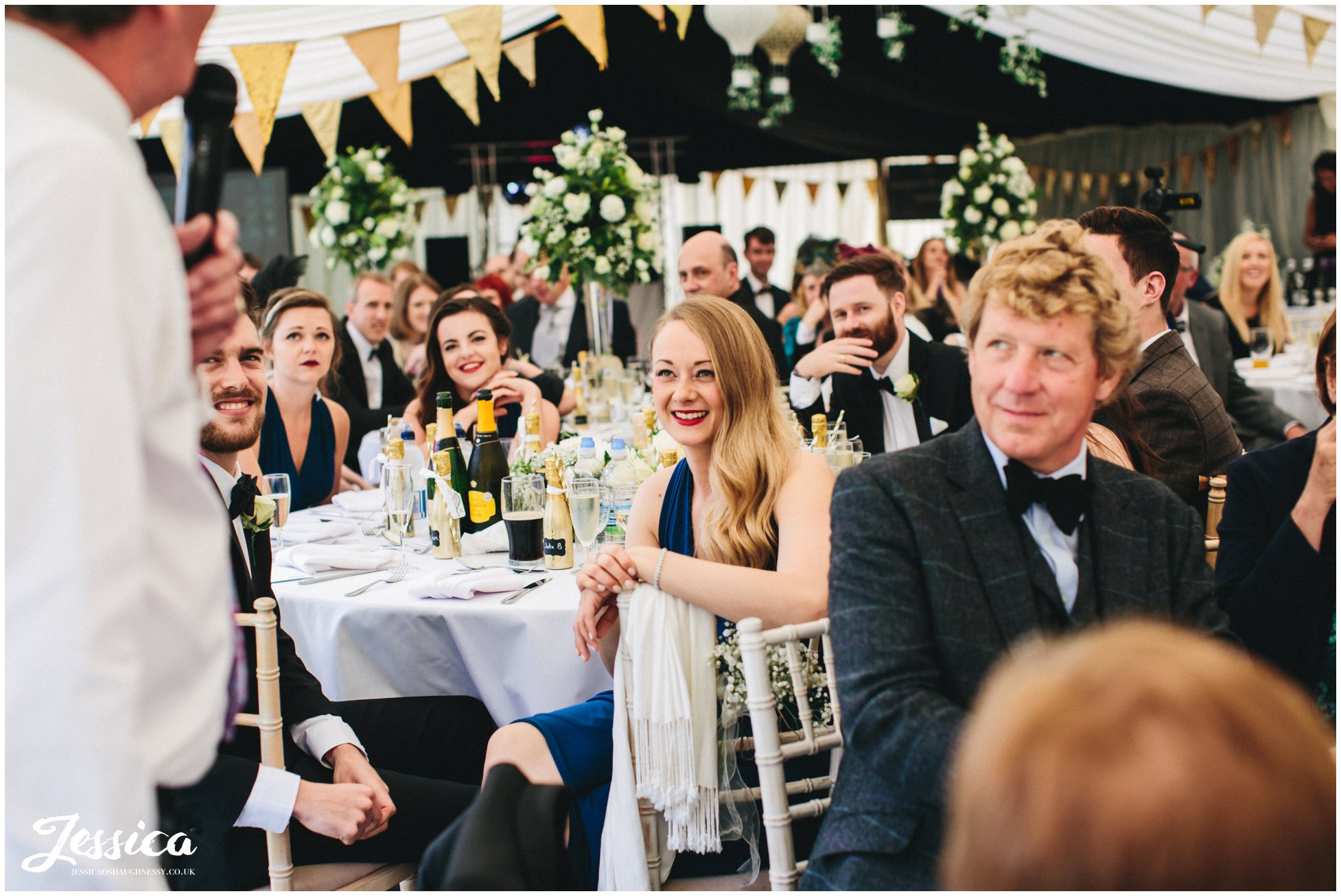 guests enjoying the speeches at the trevor hall wedding