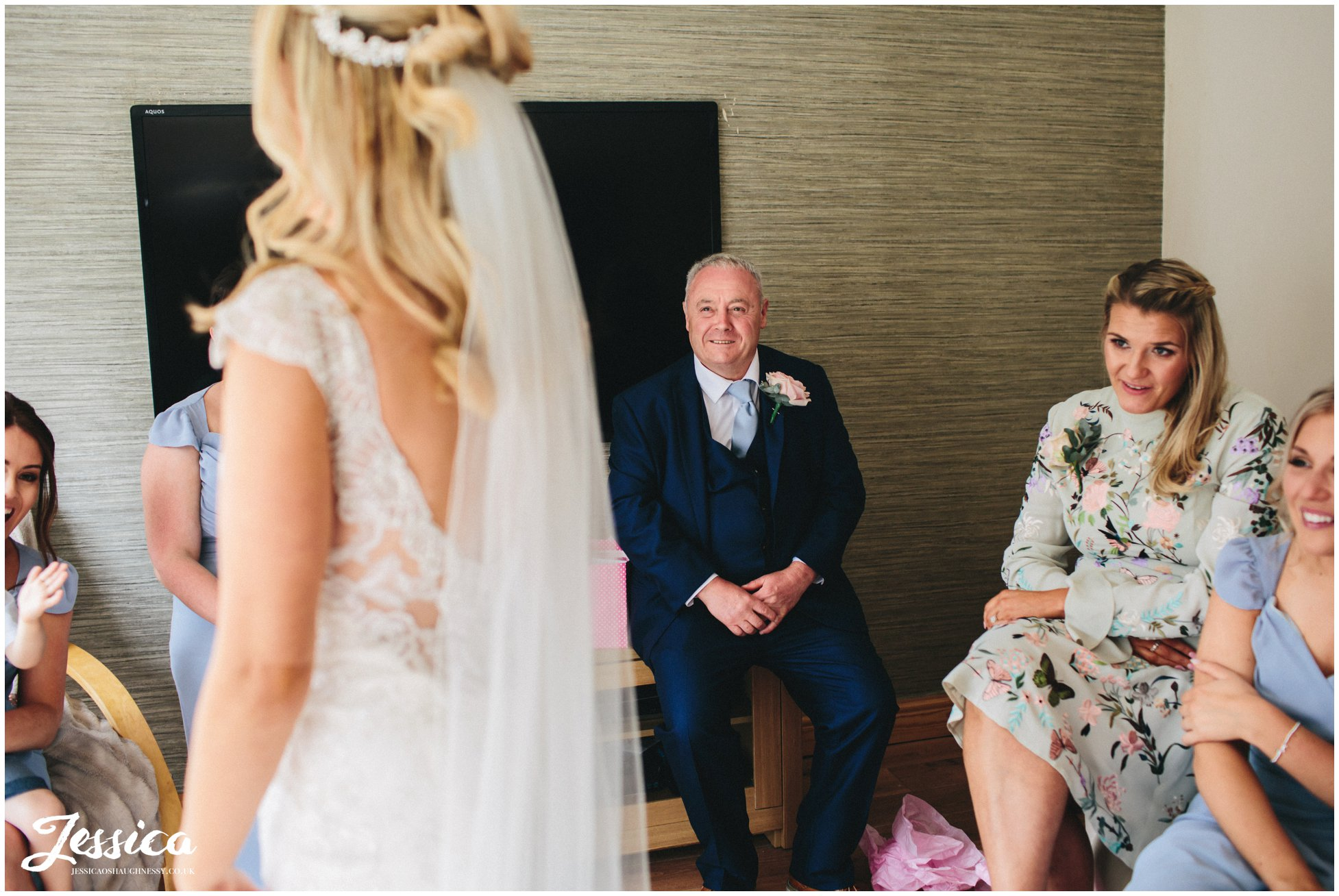 father of the bride see's daughter in her wedding dress for the first time - wirral wedding photography