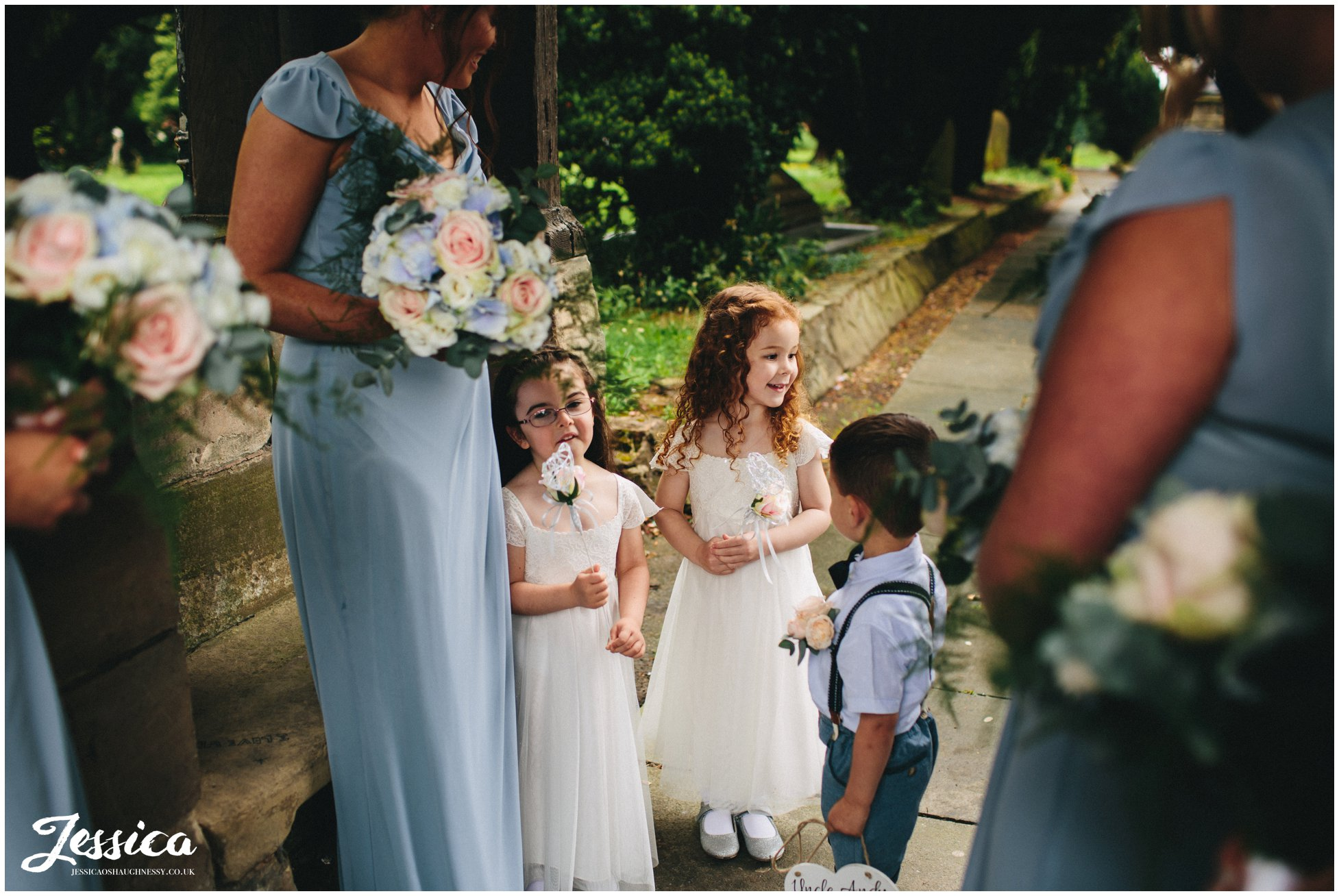 flower girls wait outside the church for the ceremony