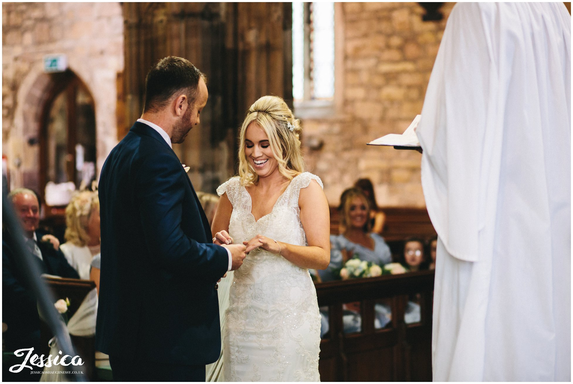 bride & groom exchange rings on their wirral wedding day