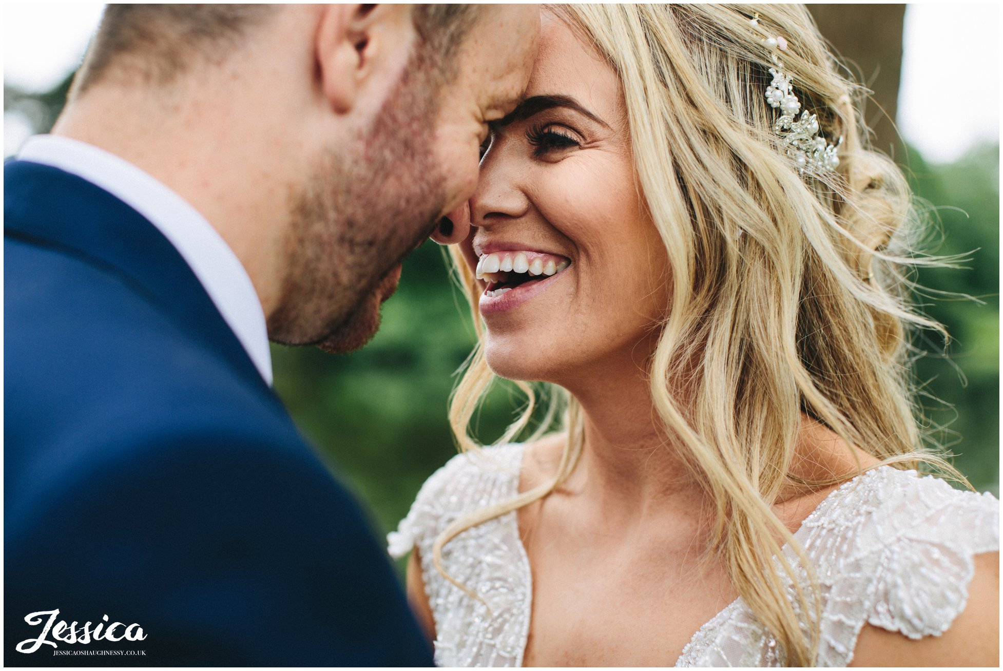 close up of bride laughing on their thornton manor wedding day
