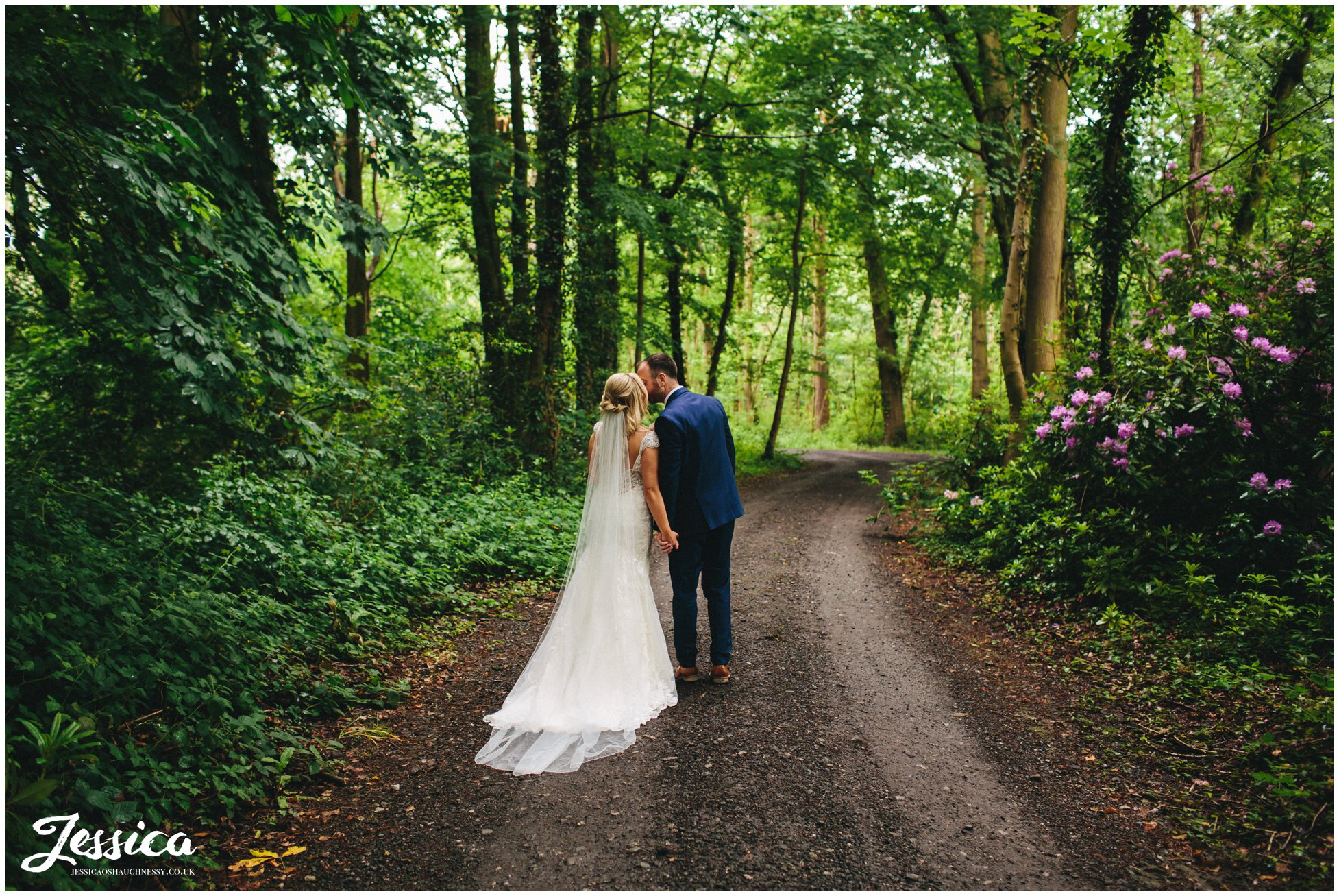 newly wed's kiss in the woodland by the lake side marquee, thornton manor