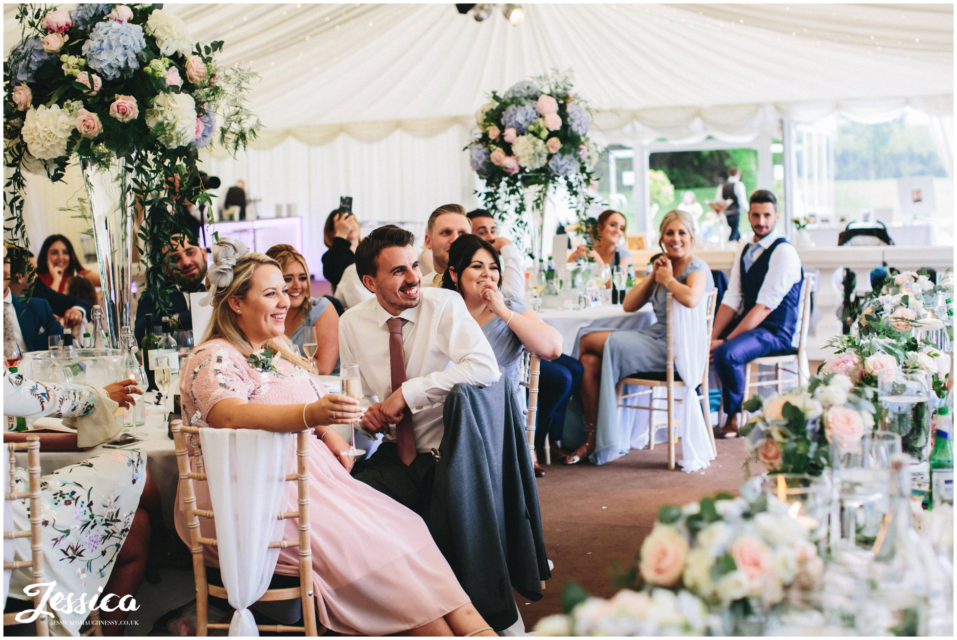 guests enjoying the speeches at a wirral wedding