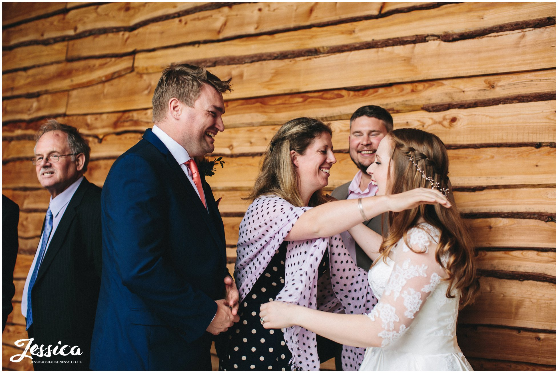 guests hug newly wed's after their north wales wedding ceremony
