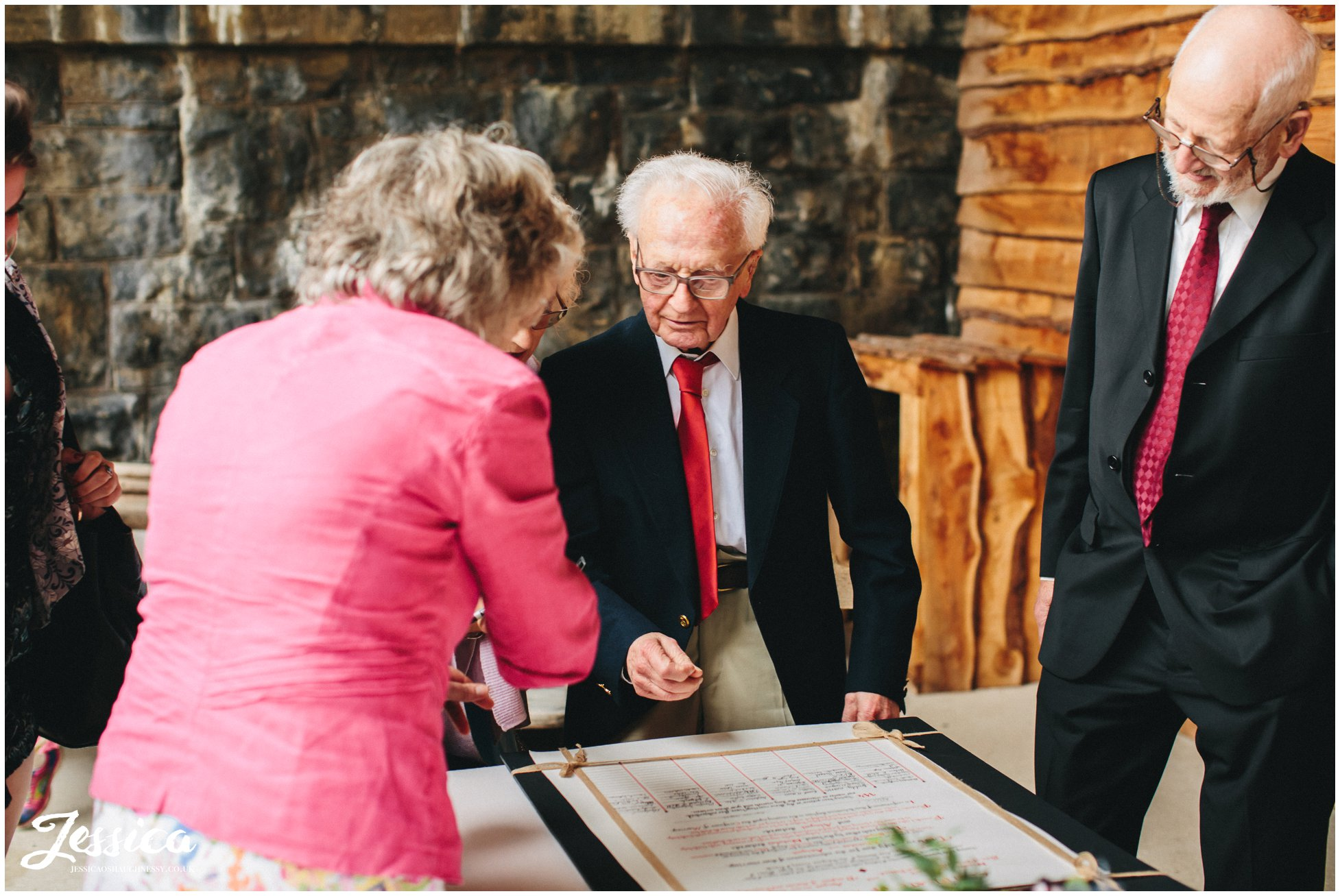guests sign quaker wedding certificate - north wales wedding photographer
