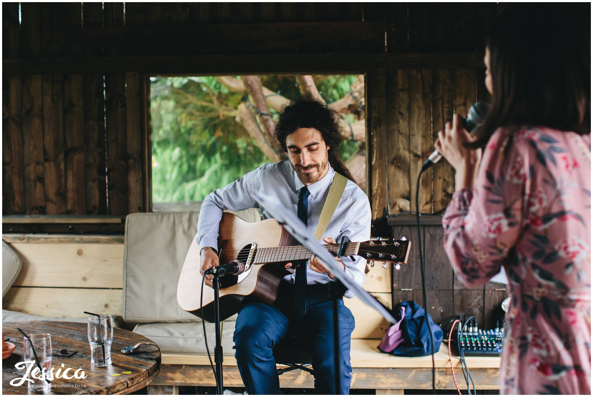 musicians play to the wedding guests in the smoking hut