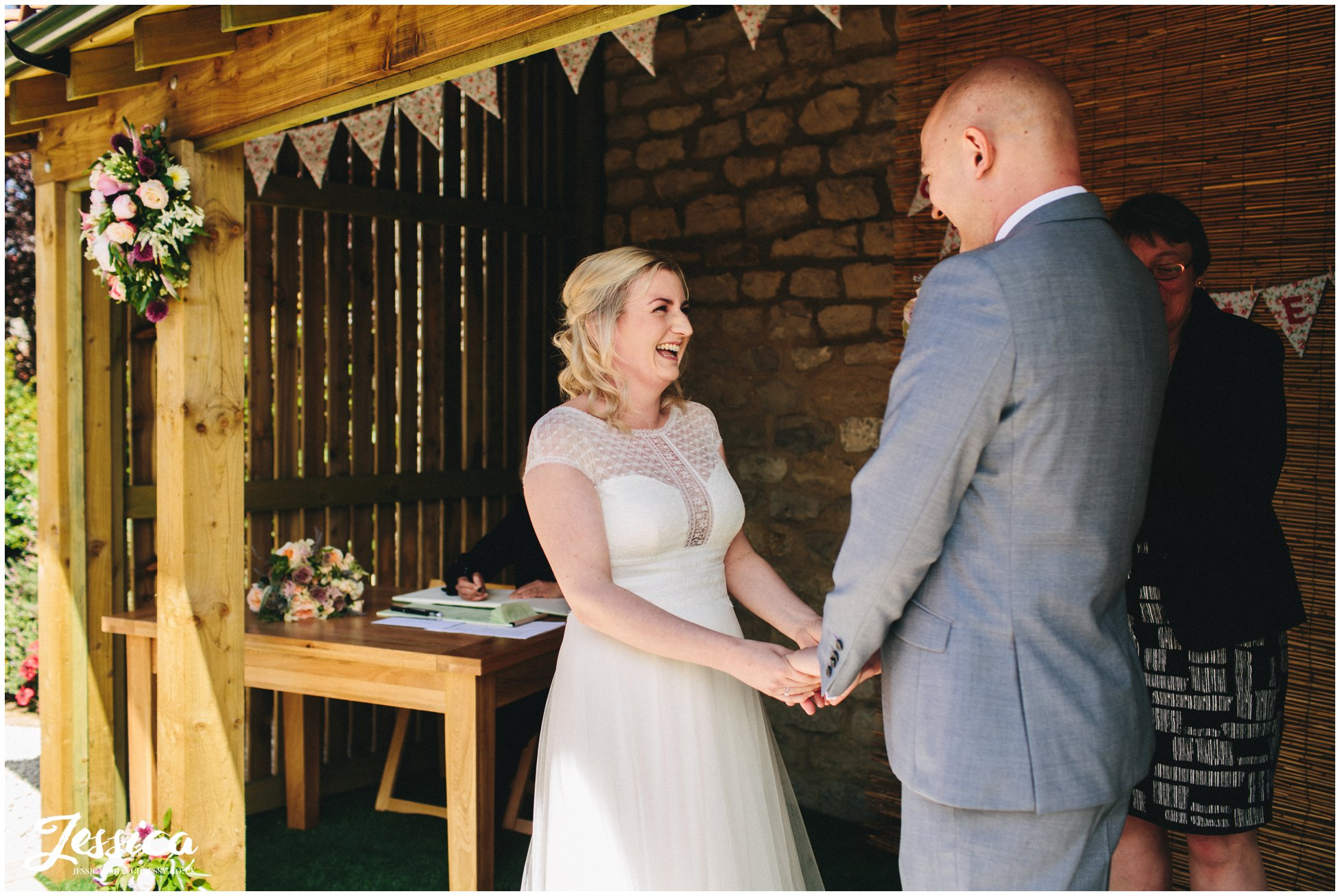 bride and groom exchange vows during their yorkshire wedding at innisfree