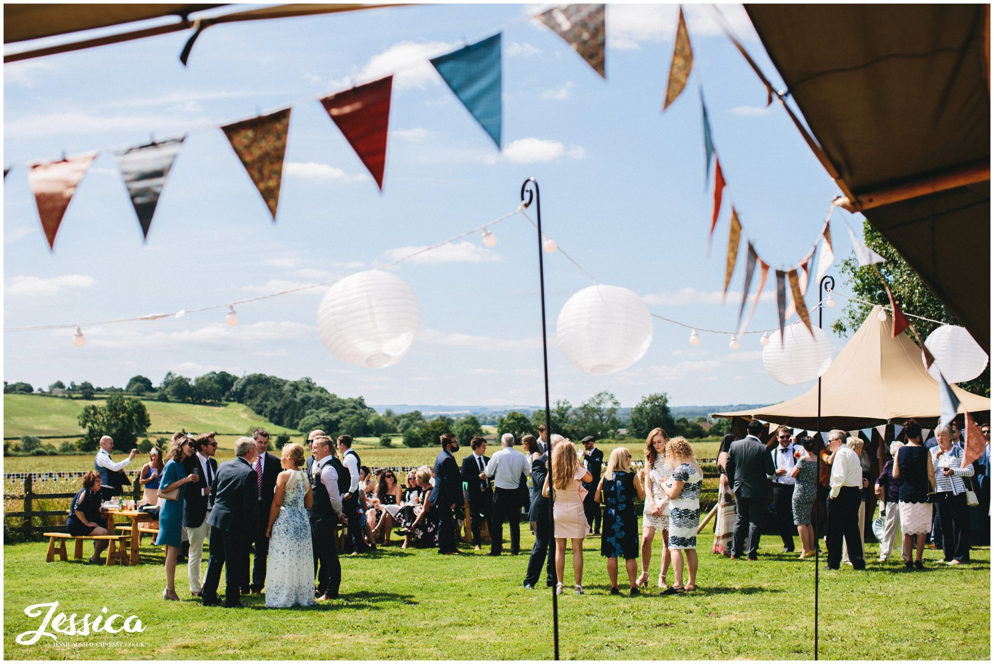guests enjoy the sunshine at a sunny yorkshire wedding