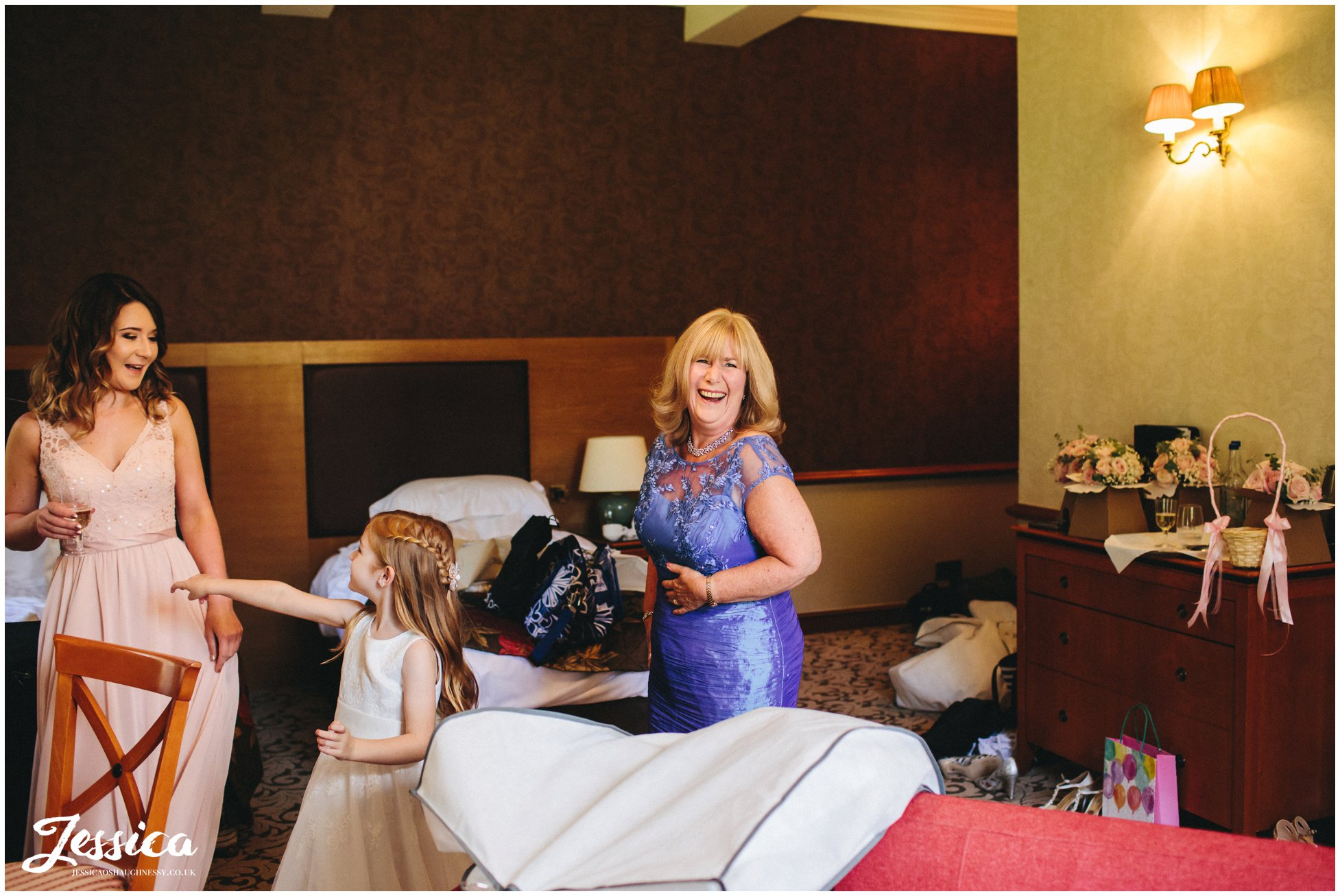 mother of the bride laughing - cheshire wedding photographer