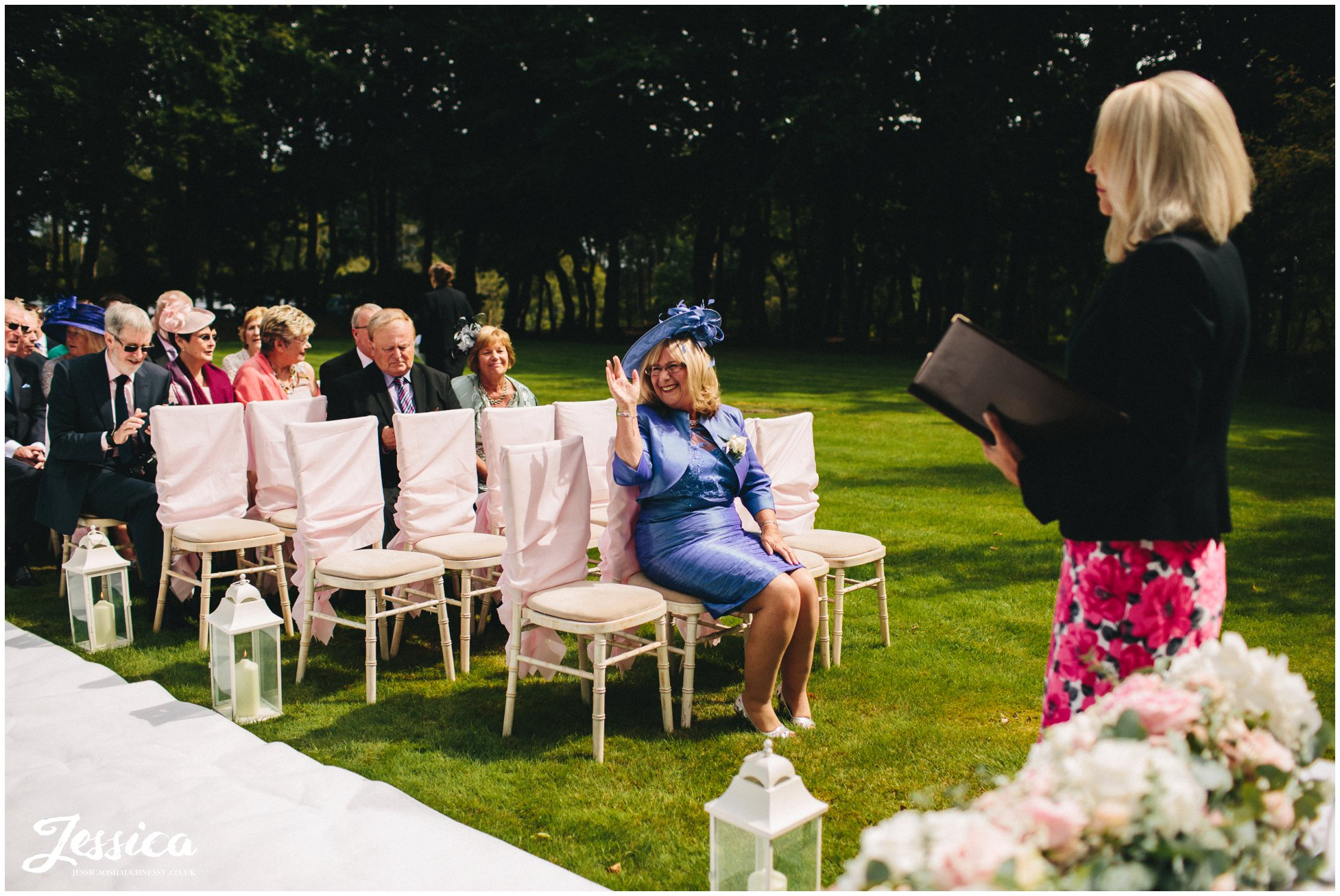mother of the bride seated for outdoor wedding ceremony at nunsmere hall