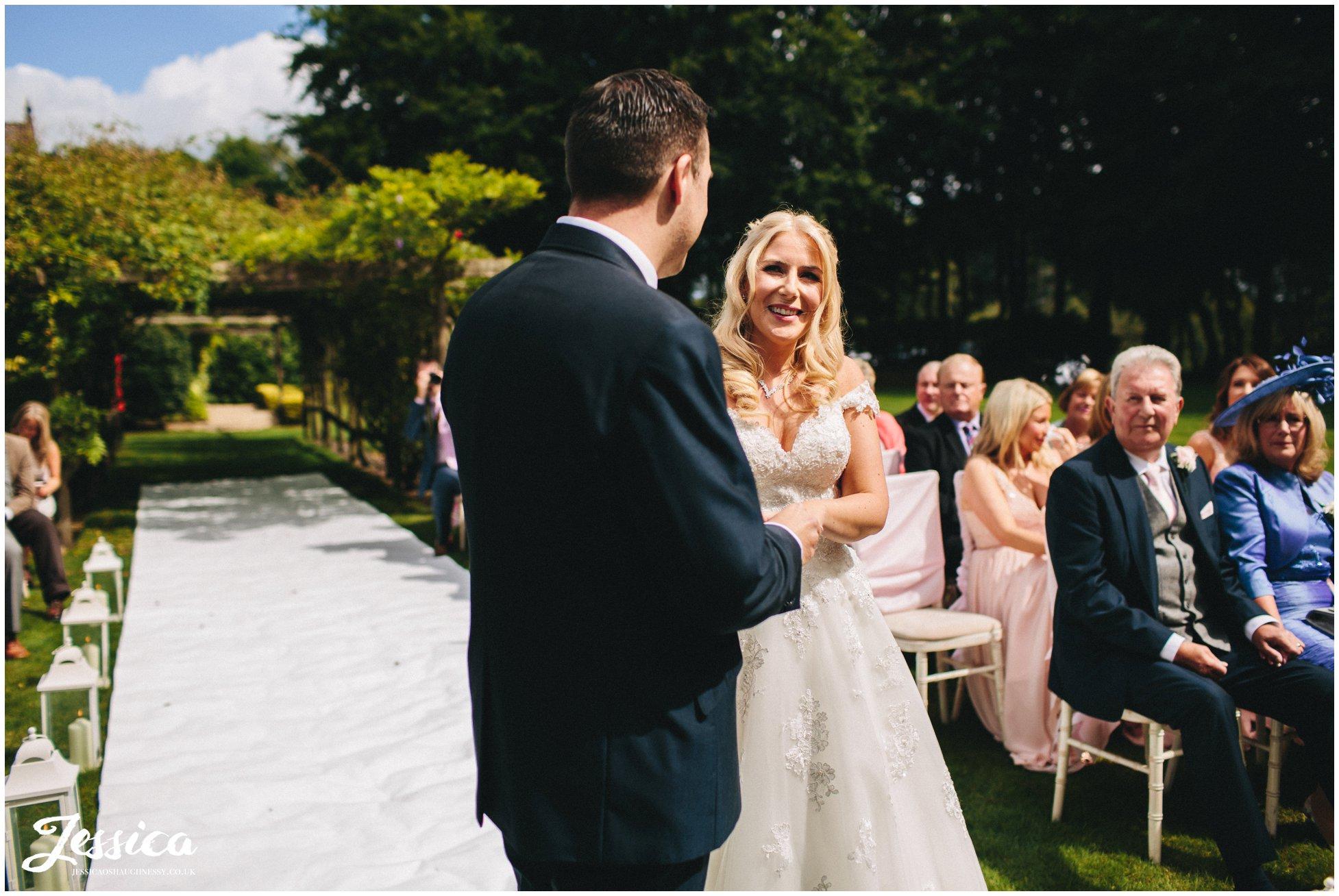 cheshire wedding photographer - bride & groom during wedding ceremony