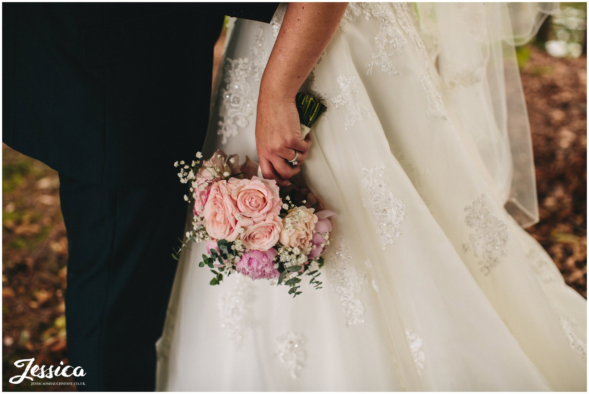 close up of bride holding bouquet - cheshire wedding photography