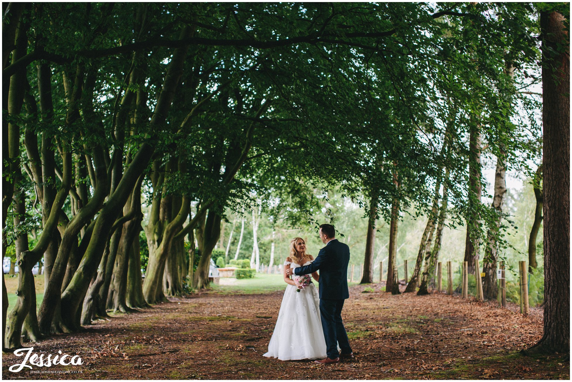bride & groom stood in the forest at nunsmere hall in cheshire