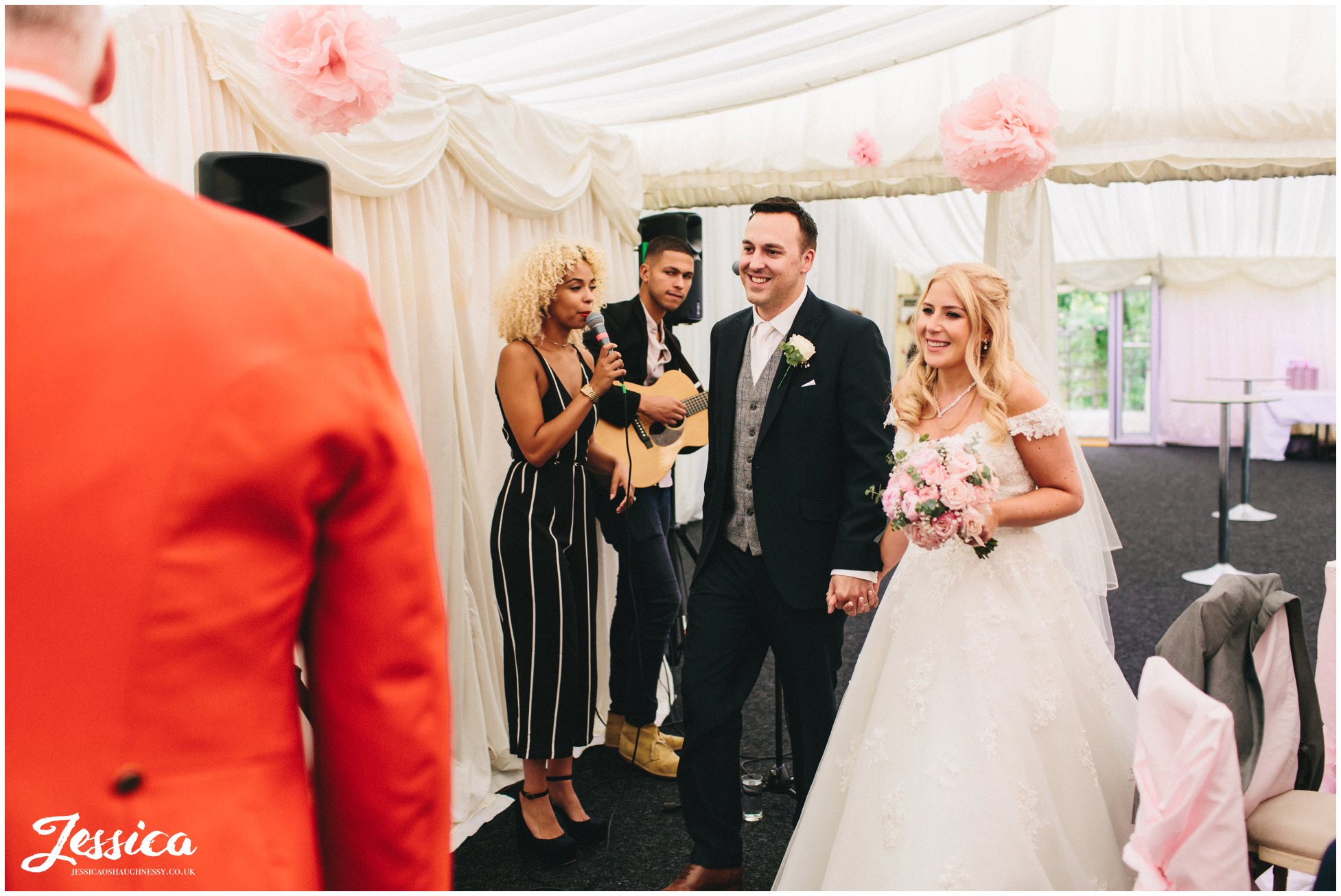 newly wed's announced into wedding breakfast at nunsmere hall