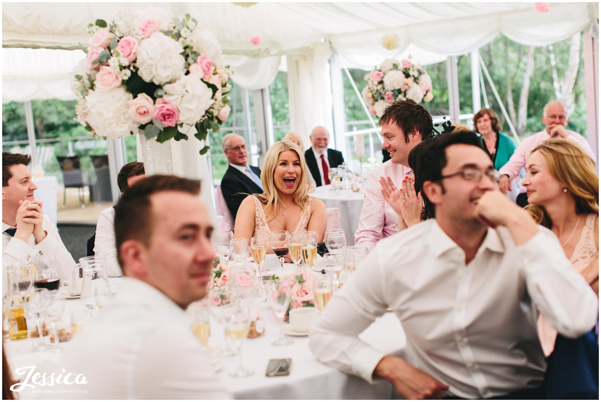 guests laughing during best mans speech in cheshire