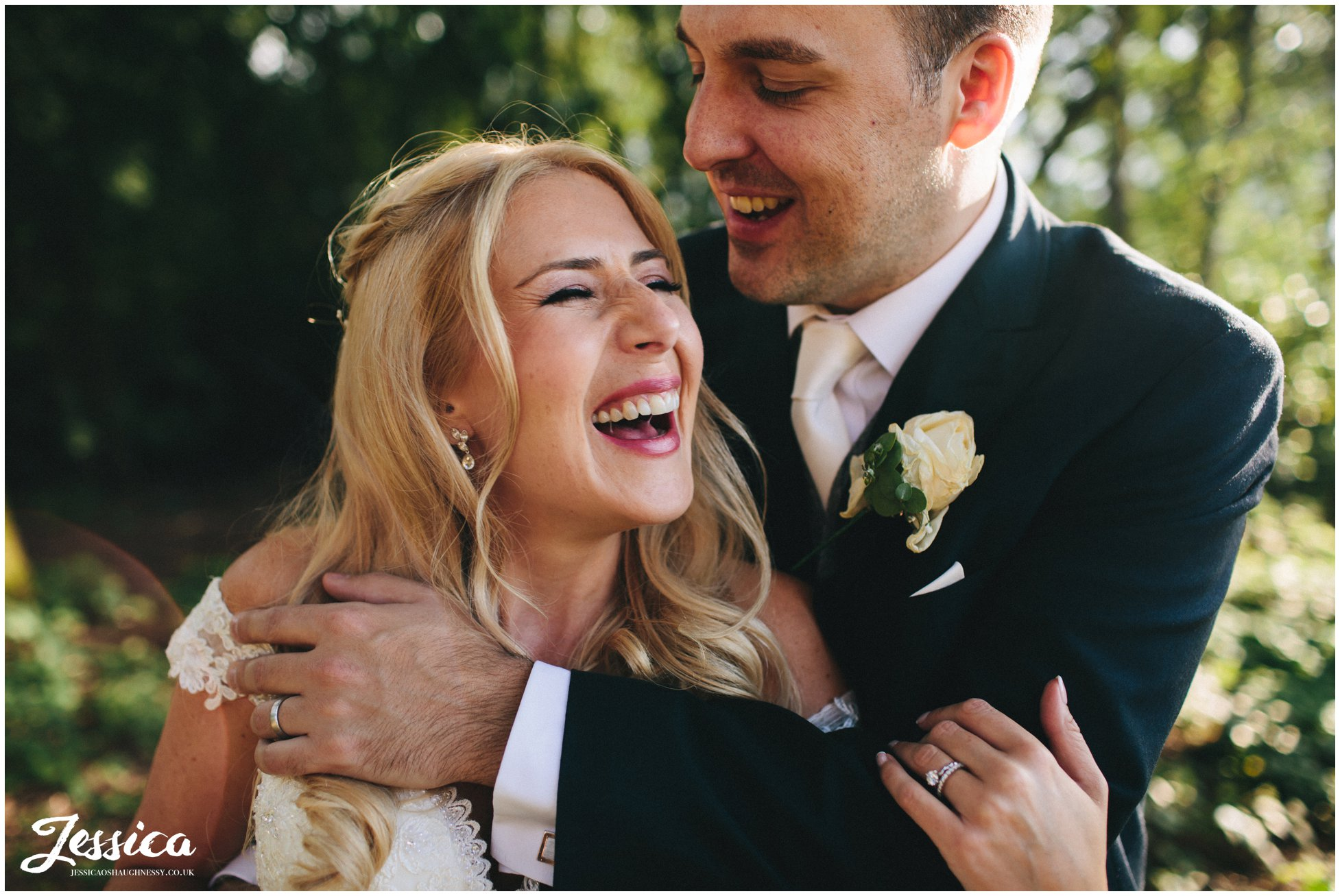 close up of bride & groom laughing - cheshire wedding photographer